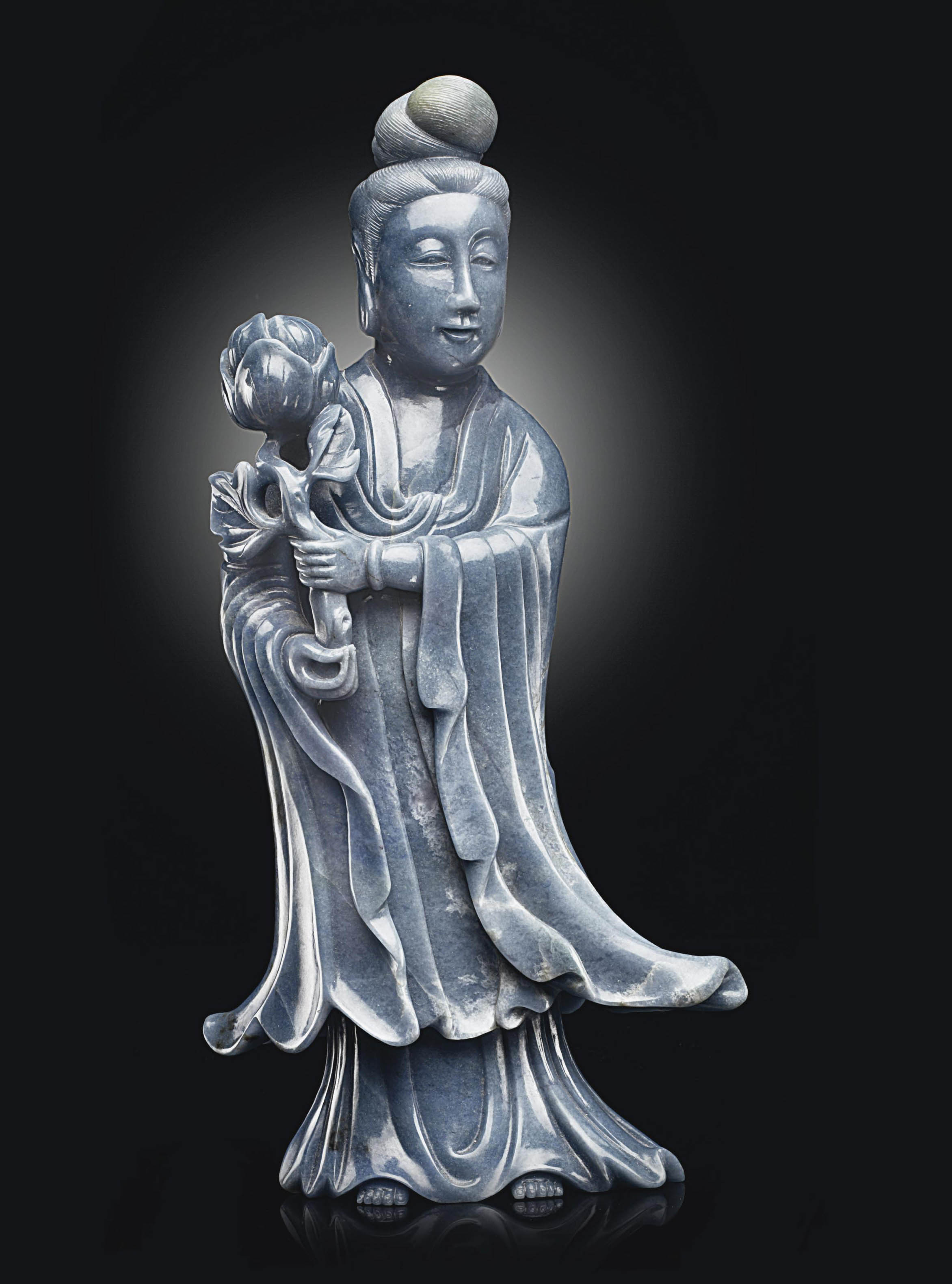 A BLUE JADEITE FIGURE OF GUANY