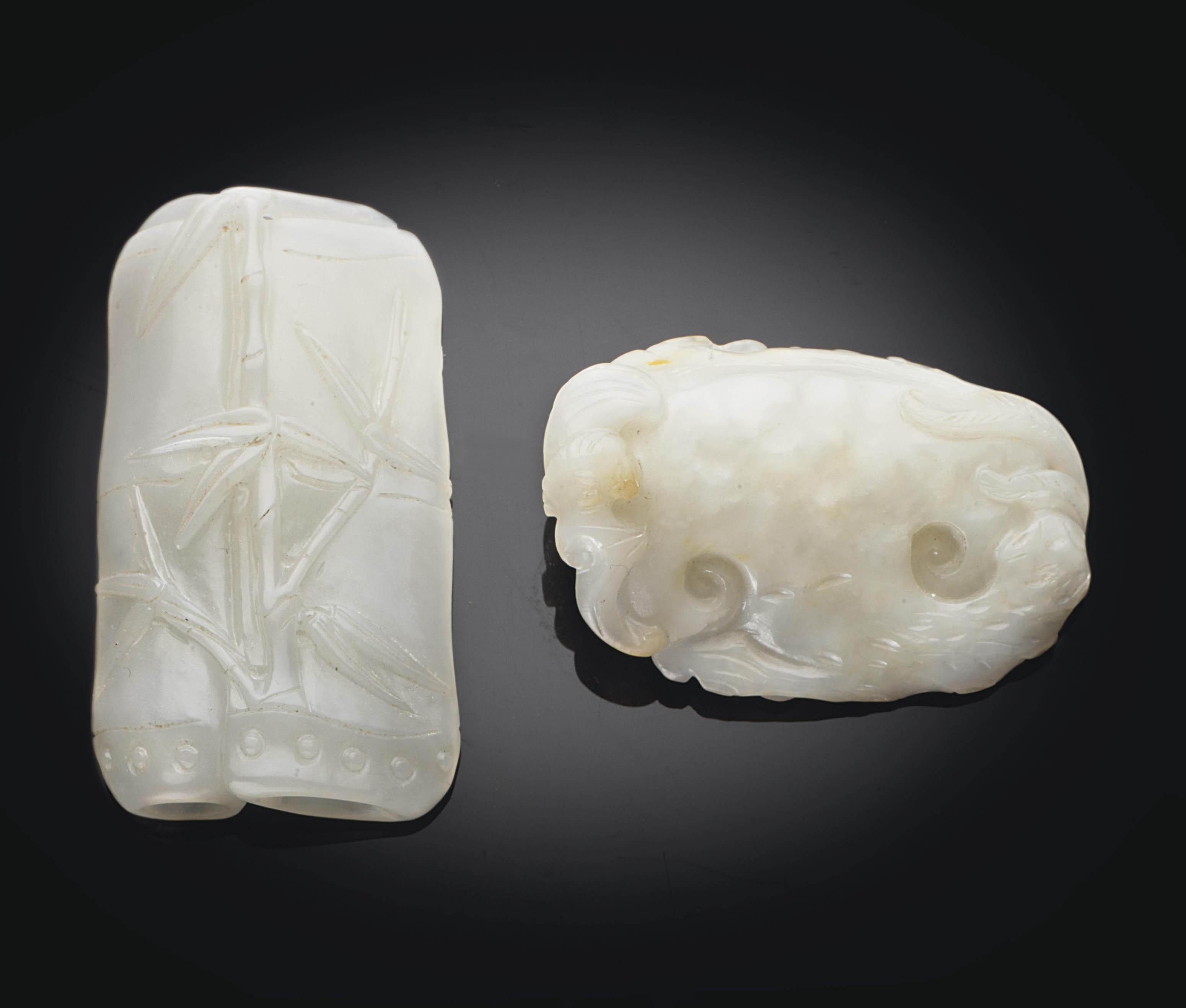 TWO WHITE JADE PENDANTS