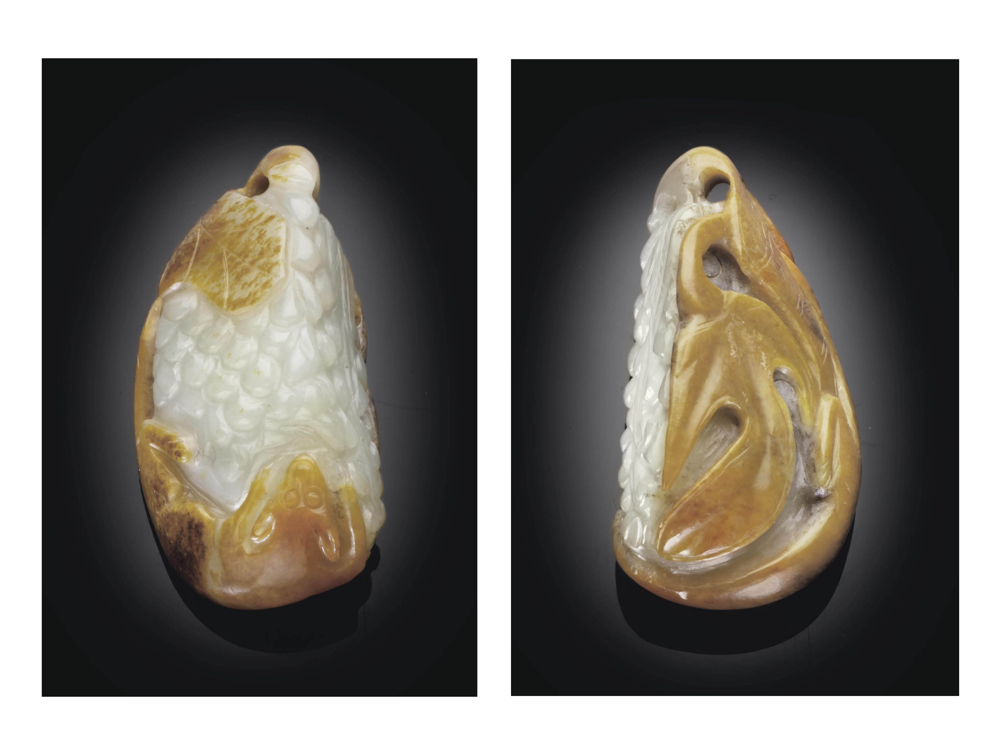 A WHITE AND RUSSET JADE PENDAN