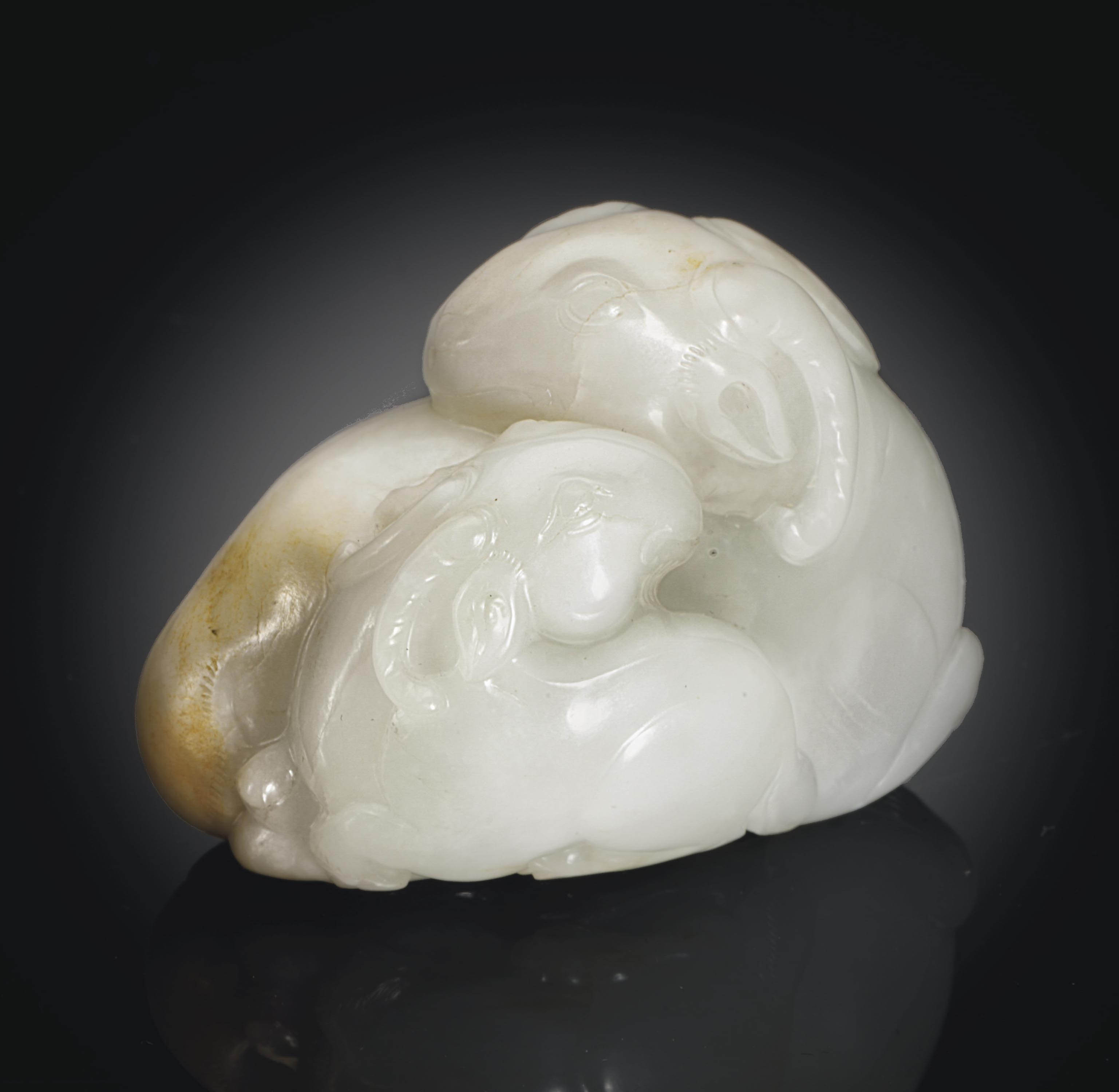 A SMALL WHITE JADE RAM GROUP