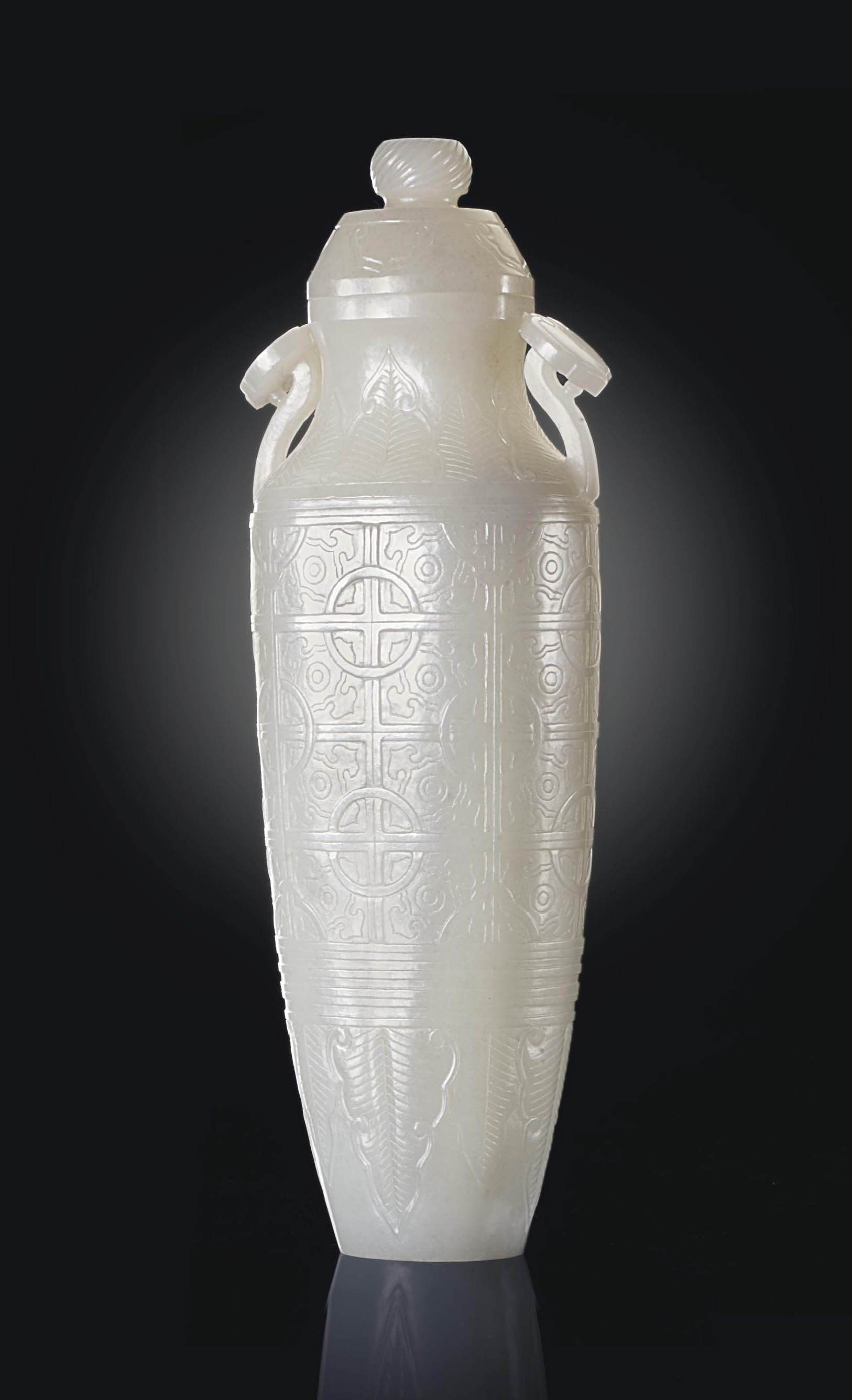 A PALE WHITE JADE SLENDER ARCH