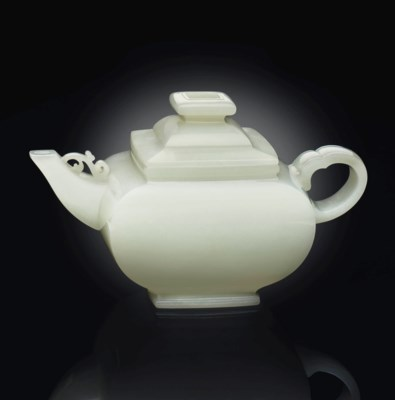 A WHITE JADE FACETED EWER AND