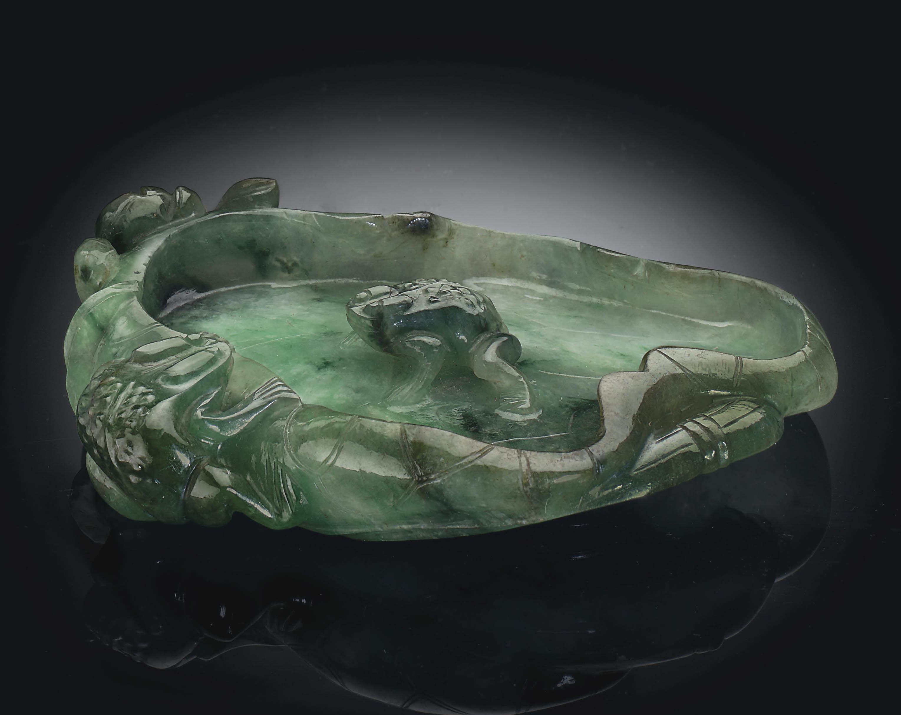 A SMALL MOTTLED GREEN JADEITE