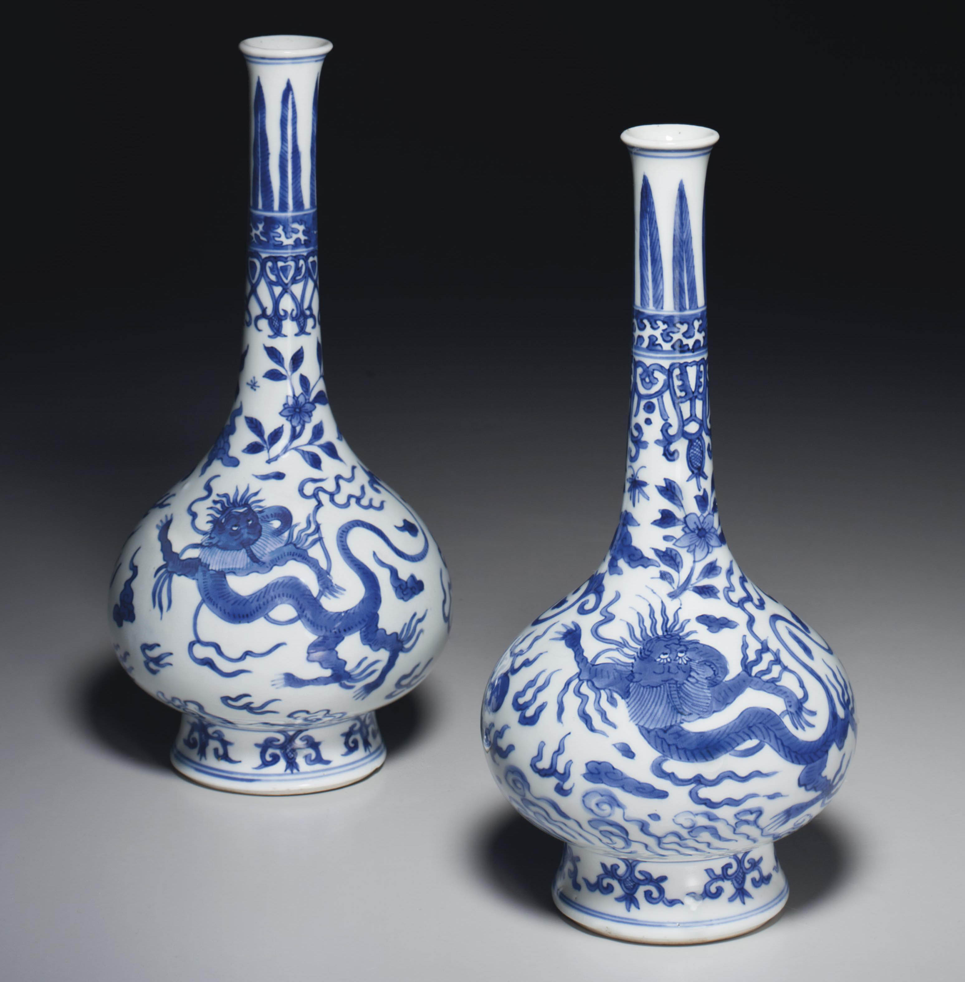 TWO BLUE AND WHITE BOTTLE VASE