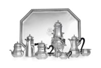 A FRENCH SILVER SEVEN-PIECE TEA AND COFFEE SERVICE WITH TRAY