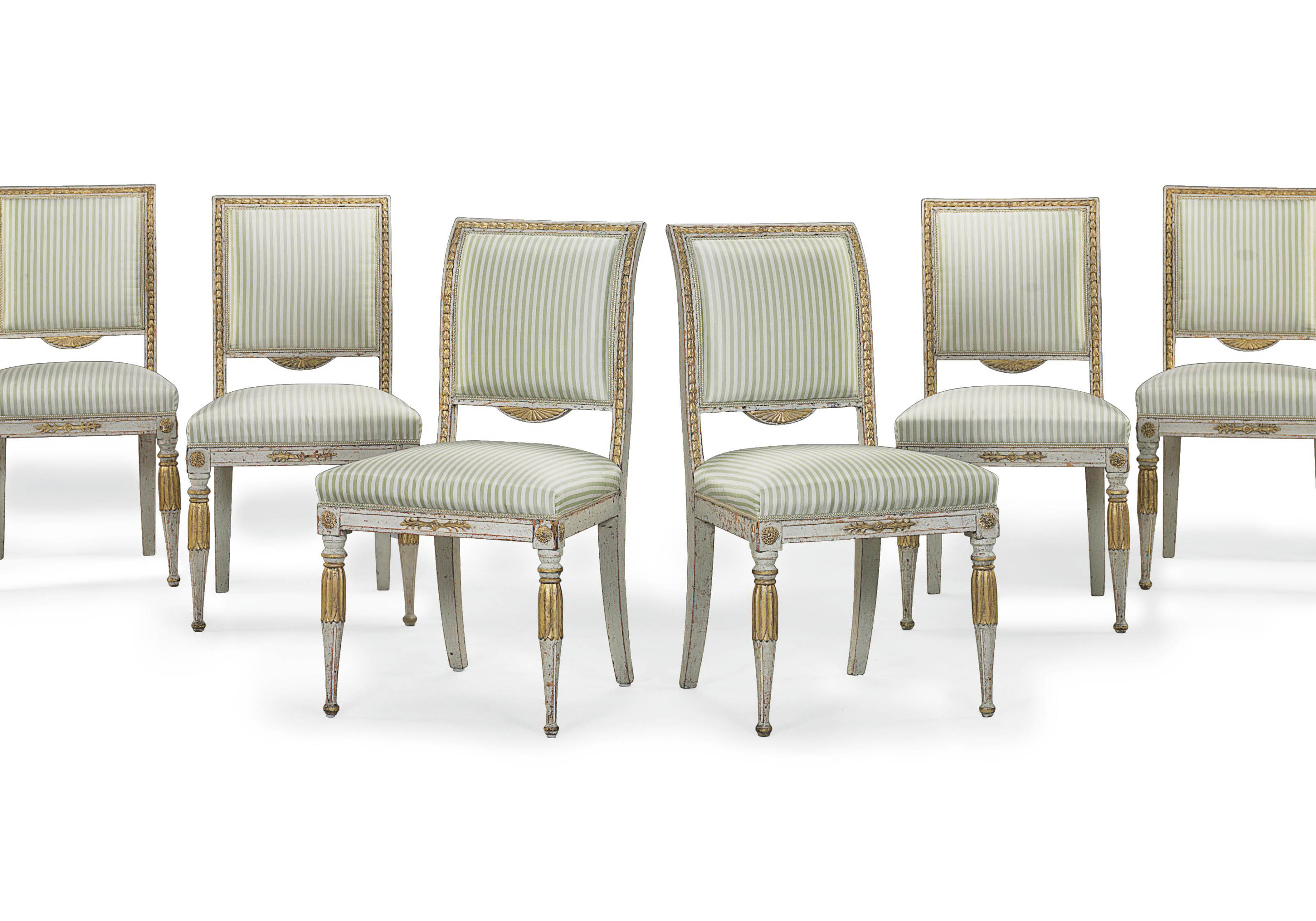 A SET OF SIX NORTH ITALIAN WHITE-PAINTED AND PARCEL-GILT SIDE CHAIRS