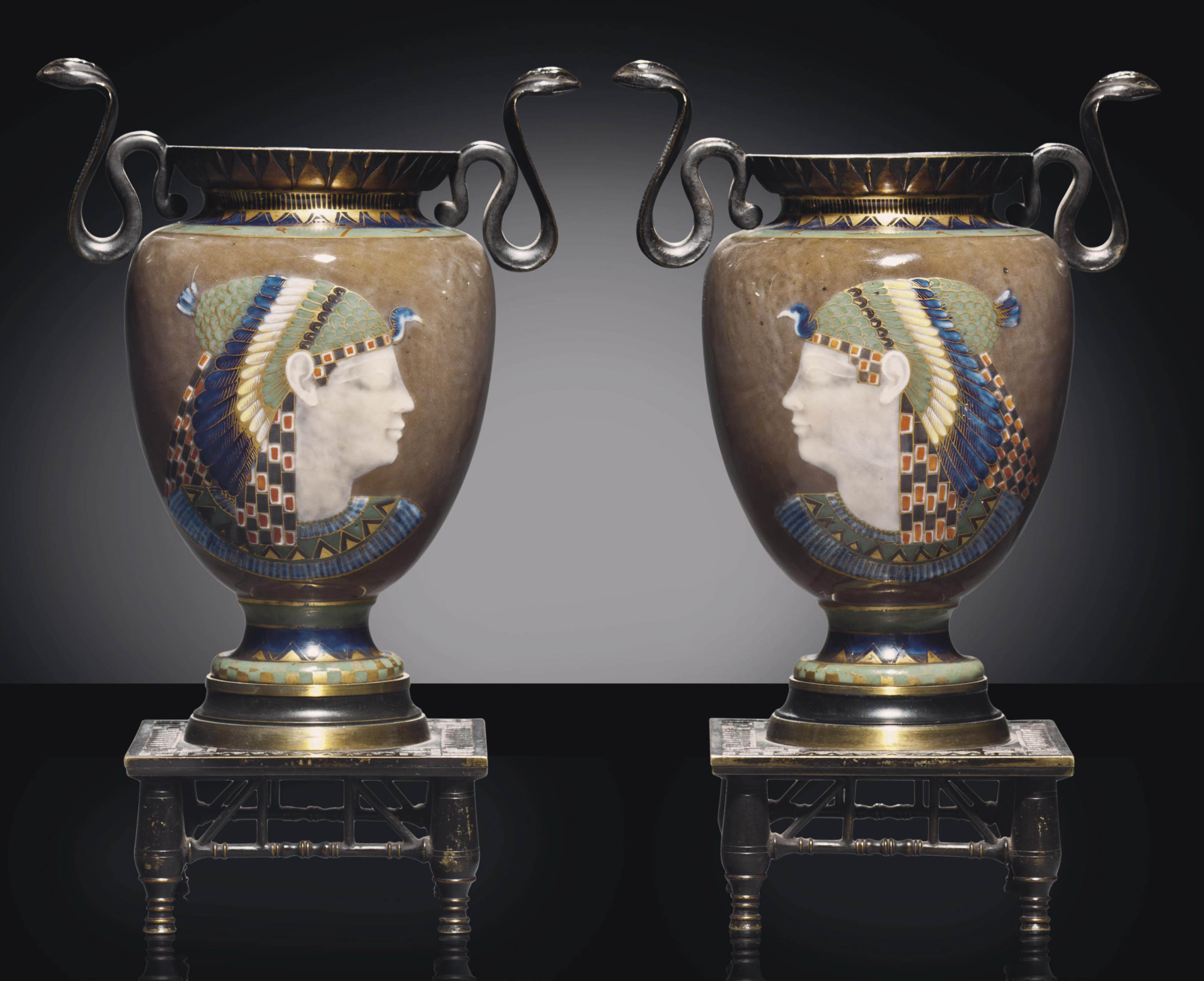 A PAIR OF PATINATED-BRONZE MOUNTED FRENCH PORCELAIN PATE D'APPLICATION EGYPTIAN REVIVAL SMOKEY-BROWN GROUND VASES