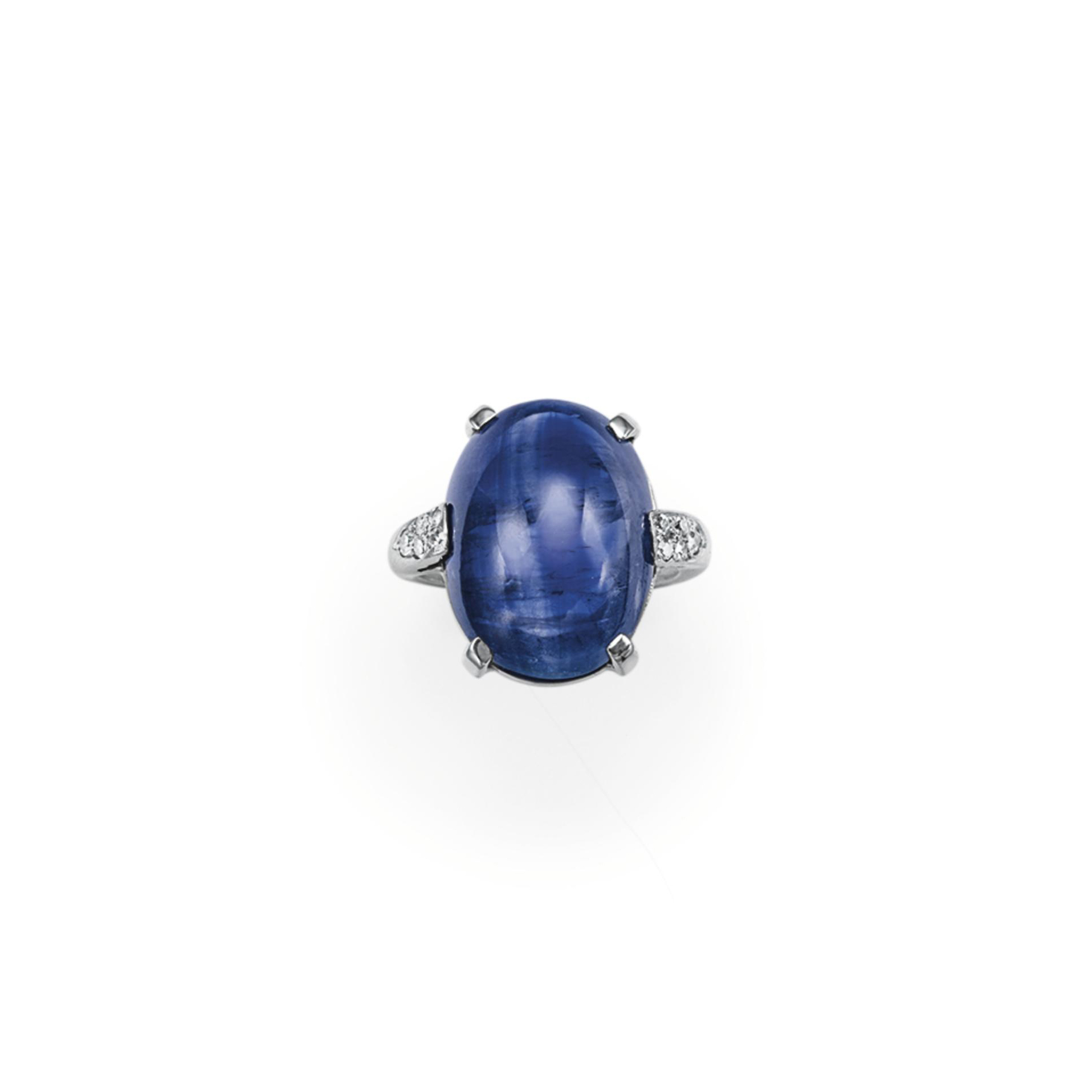 A SAPPHIRE AND DIAMOND RING, BY SEAMAN SCHEPPS