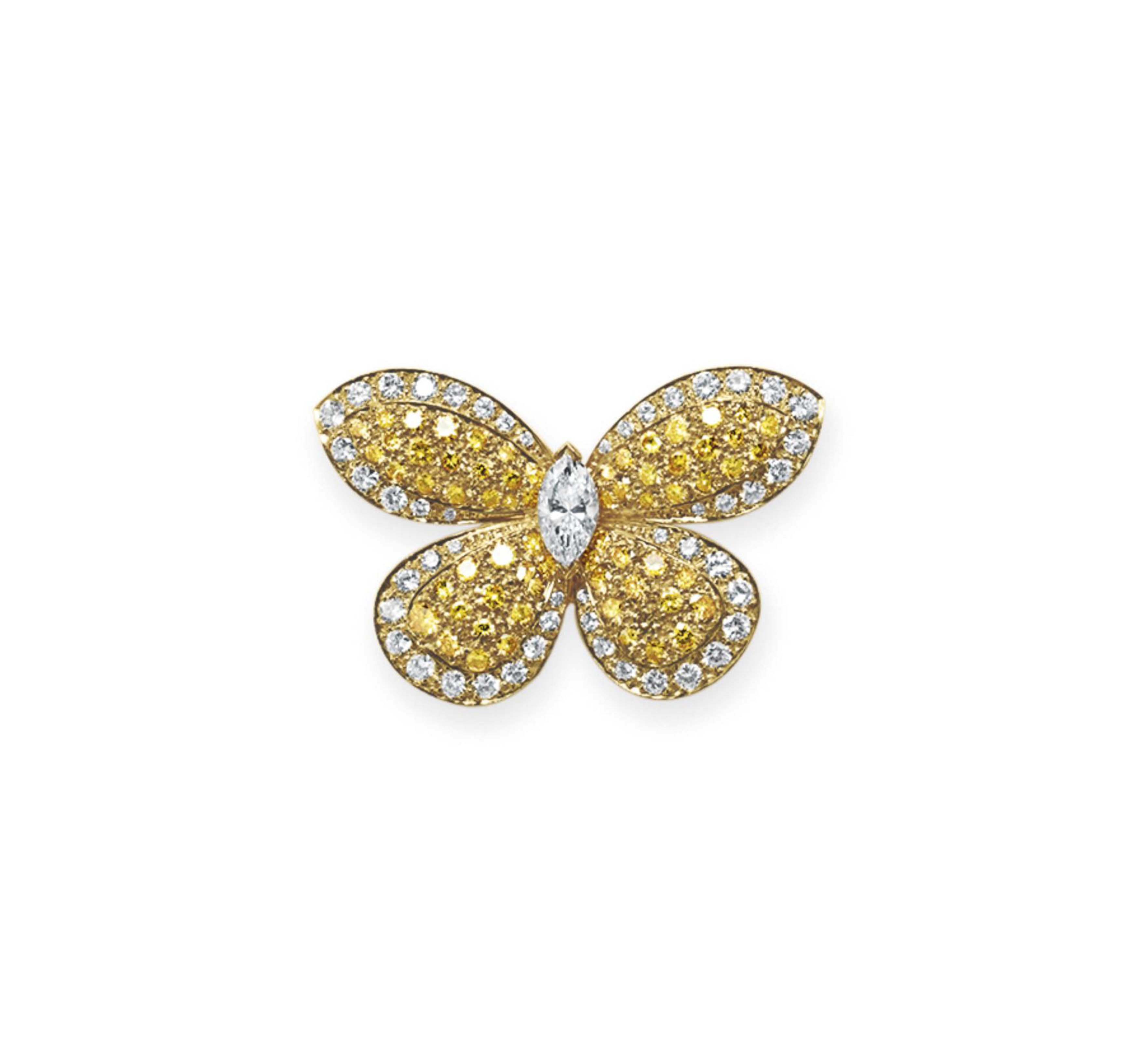 A DIAMOND AND COLORED DIAMOND BROOCH, BY VAN CLEEF ...
