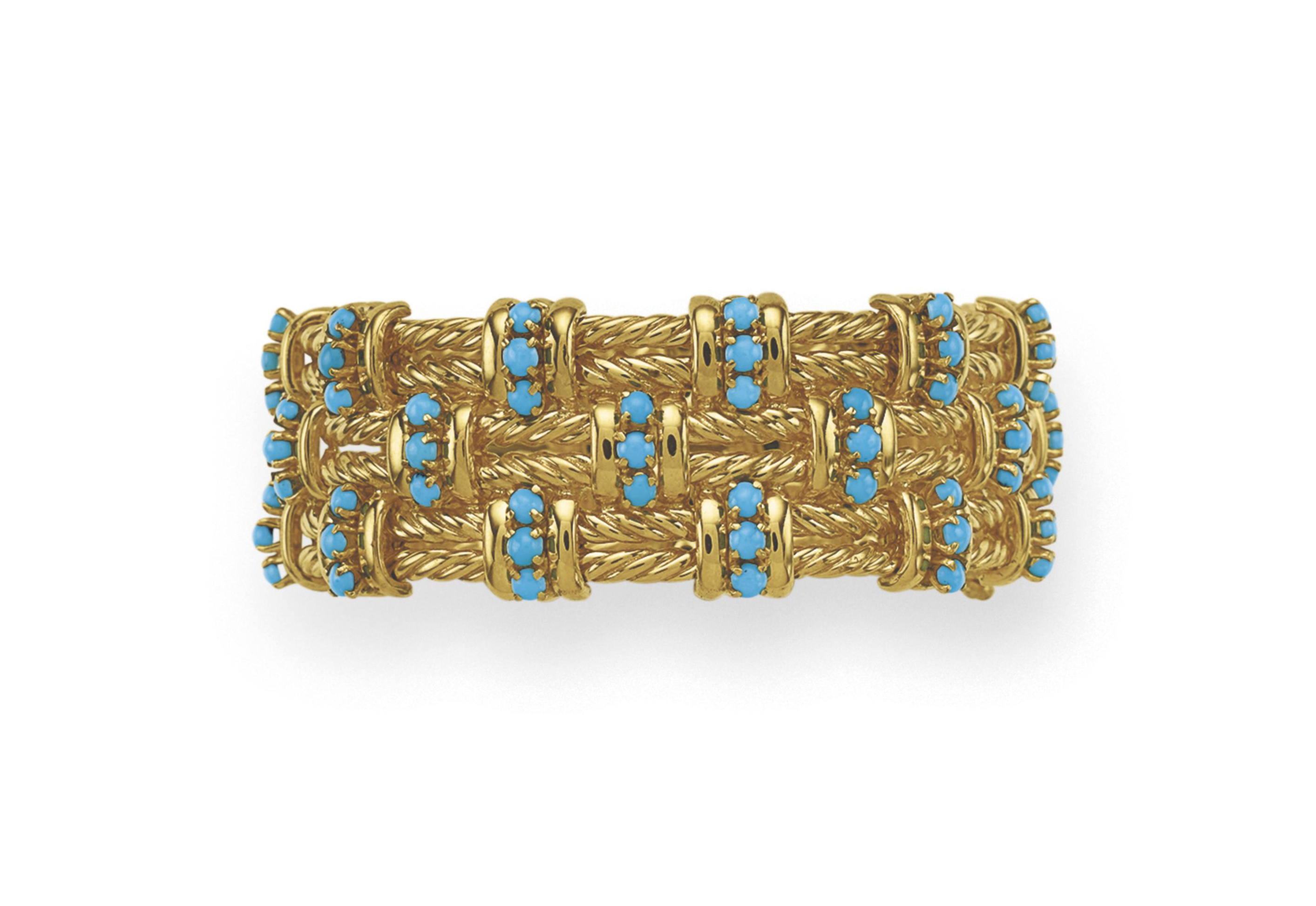 A TURQUOISE AND GOLD BRACELET,