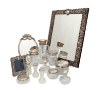 AN AMERICAN SILVER-MOUNTED DRESSING MIRROR AND A GROUP OF SILVER-MOUNTED TOILETTE ARTICLES,