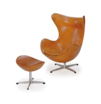 AN ALUMINUM AND LEATHER UPHOLSTERED 'EGG' LOUNGE CHAIR AND OTTOMAN,