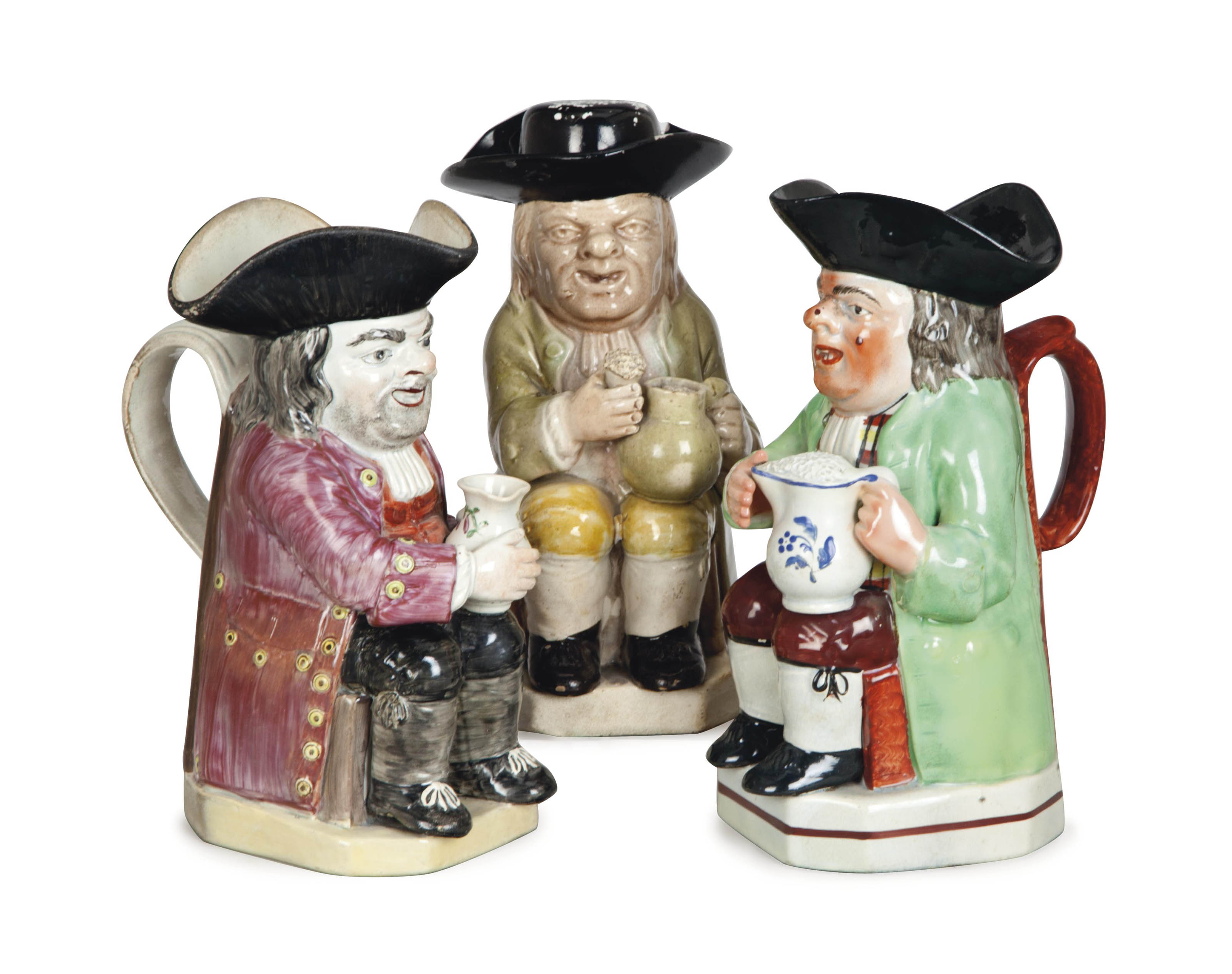 THREE STAFFORDSHIRE CREAMWARE 'COLLIER' TOBY JUGS,