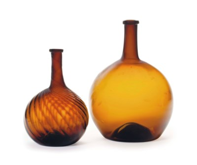 A RIBBED BLOWN GLASS BOTTLE