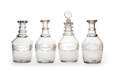 A GROUP OF FOUR BLOWN GLASS DE