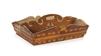 A CARVED AND INLAID MAHOGANY,