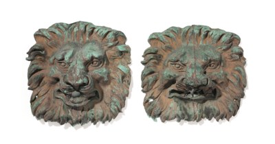 A PAIR OF MOLDED COPPER ORNAME