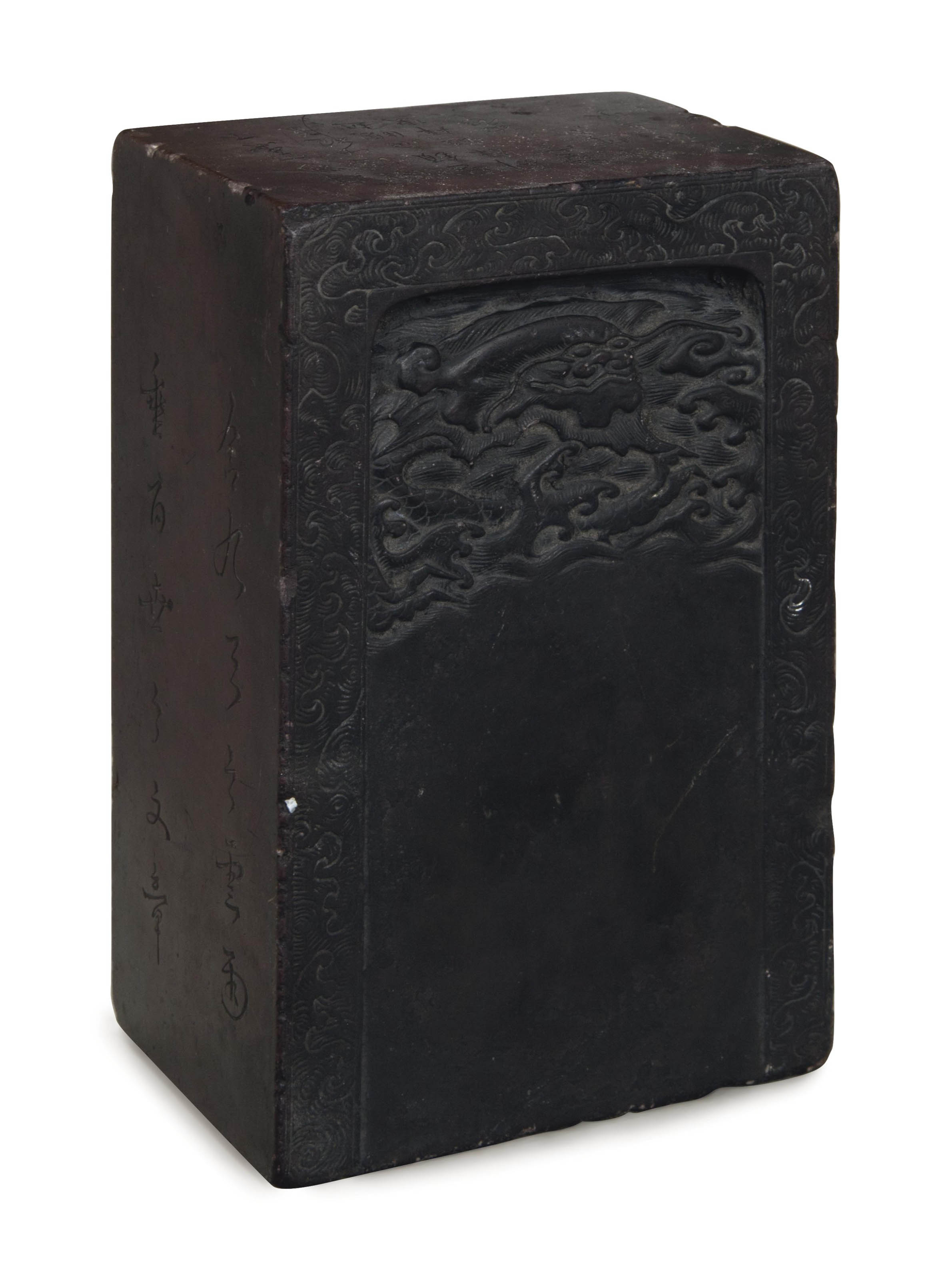 A CHINESE CARVED AND INSCRIBED INKSTONE,