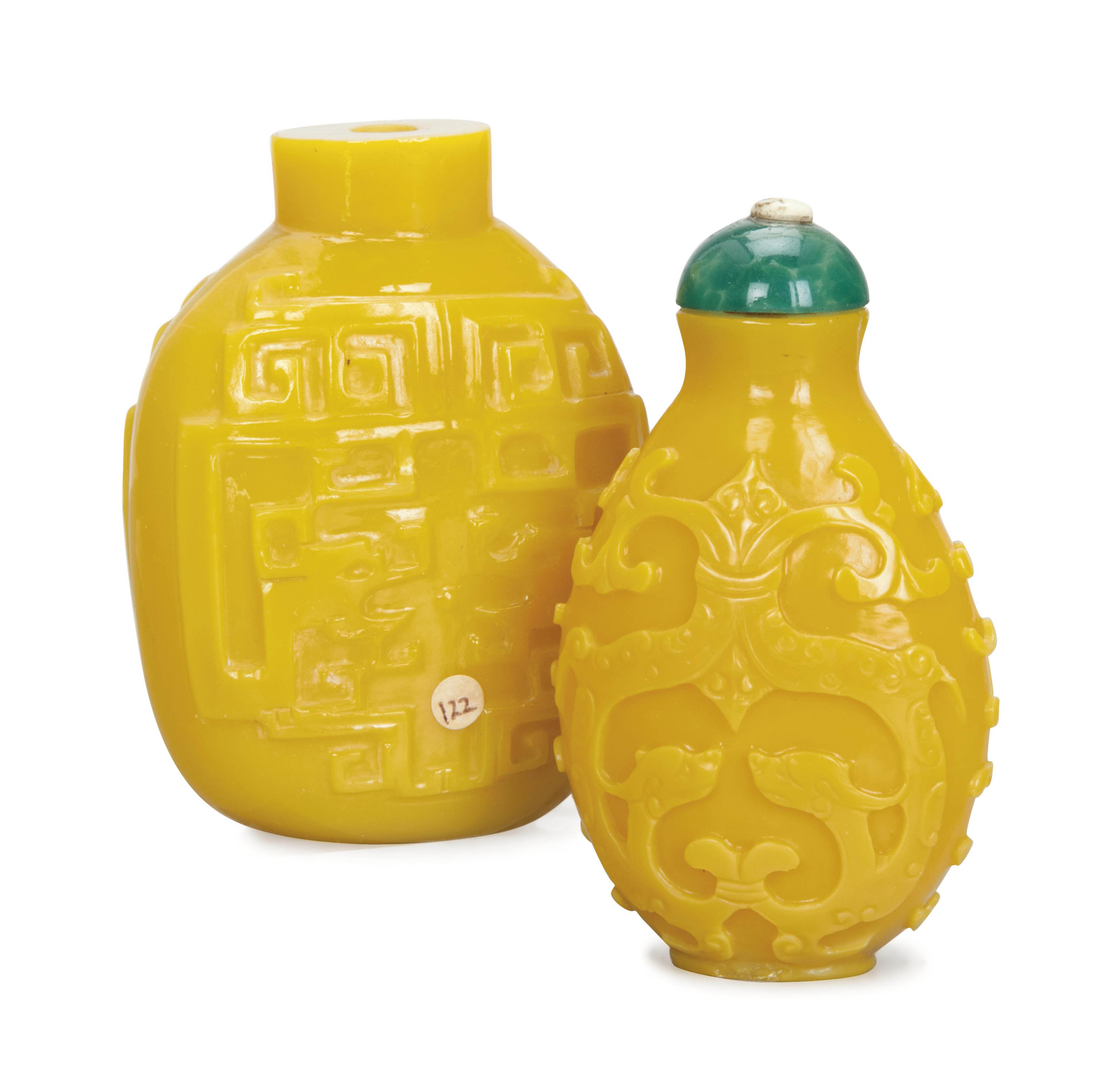 TWO CHINESE CARVED YELLOW SNUFF BOTTLES,