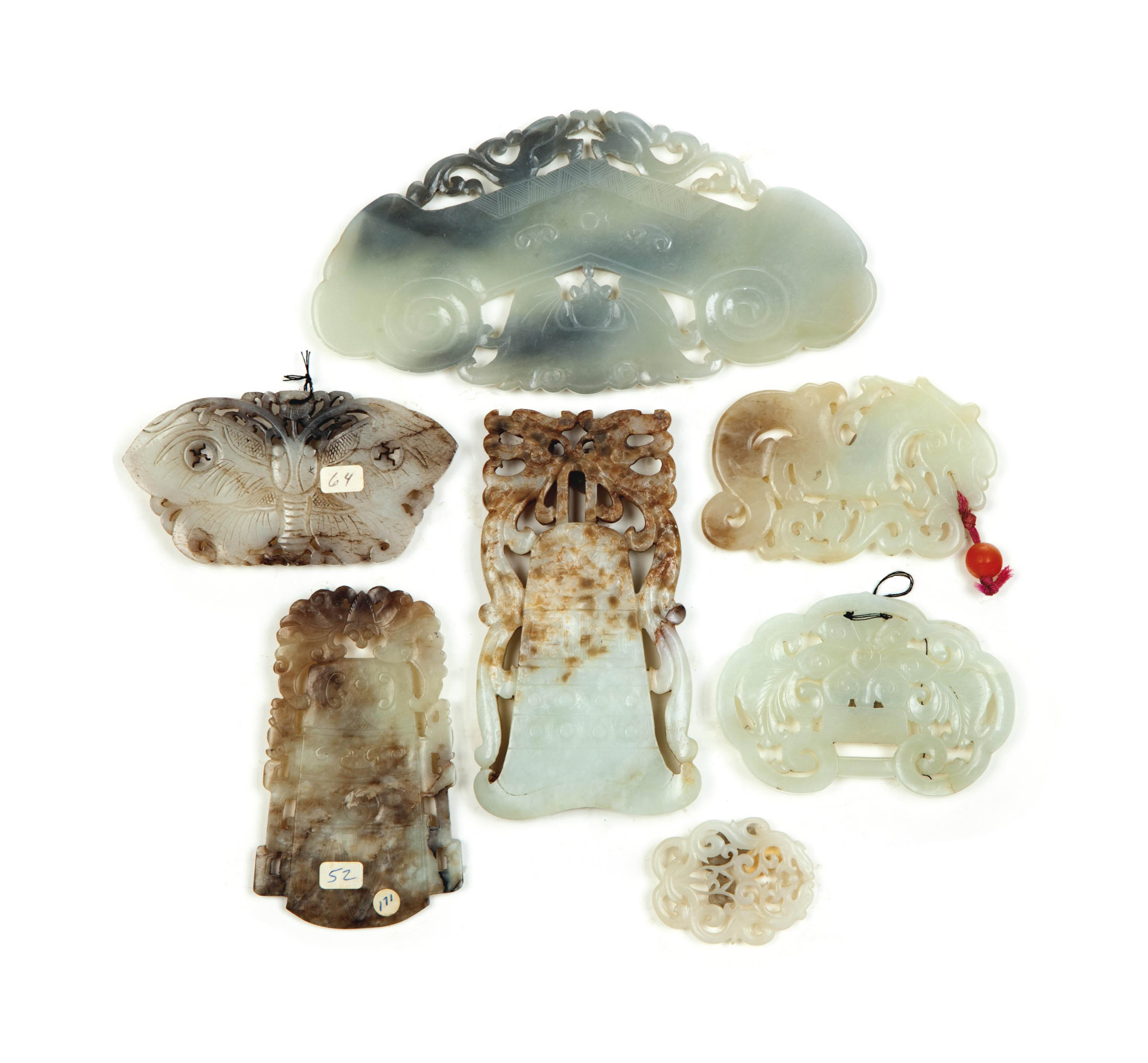 SEVEN CHINESE PALE BEIGE AND GREY JADE ARCHAISTIC PENDANTS