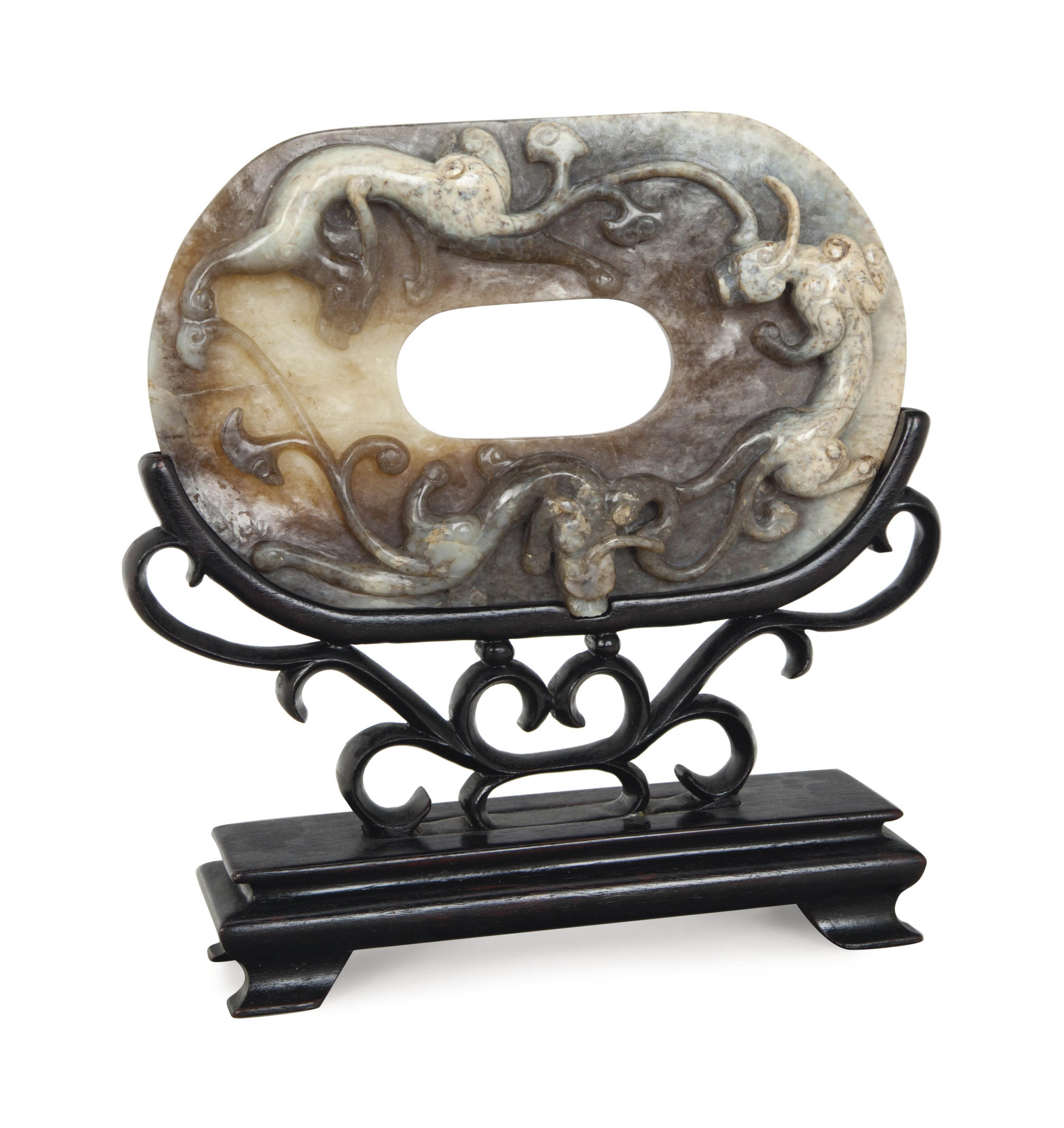A CHINESE BROWN AND GREY JADE OVAL ARCHAISTIC CARVING,