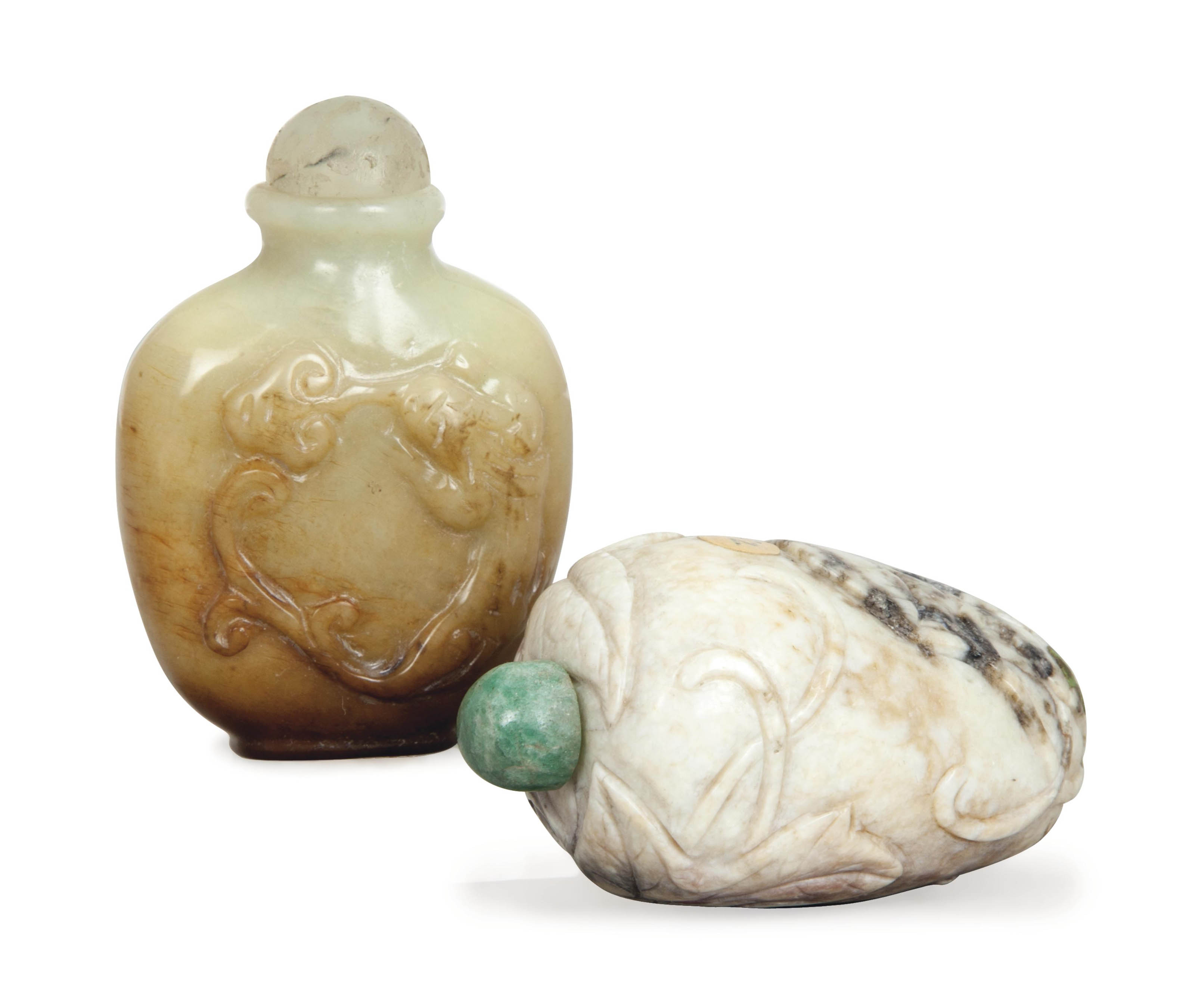 TWO CARVED CHINESE JADE SNUFF BOTTLES,
