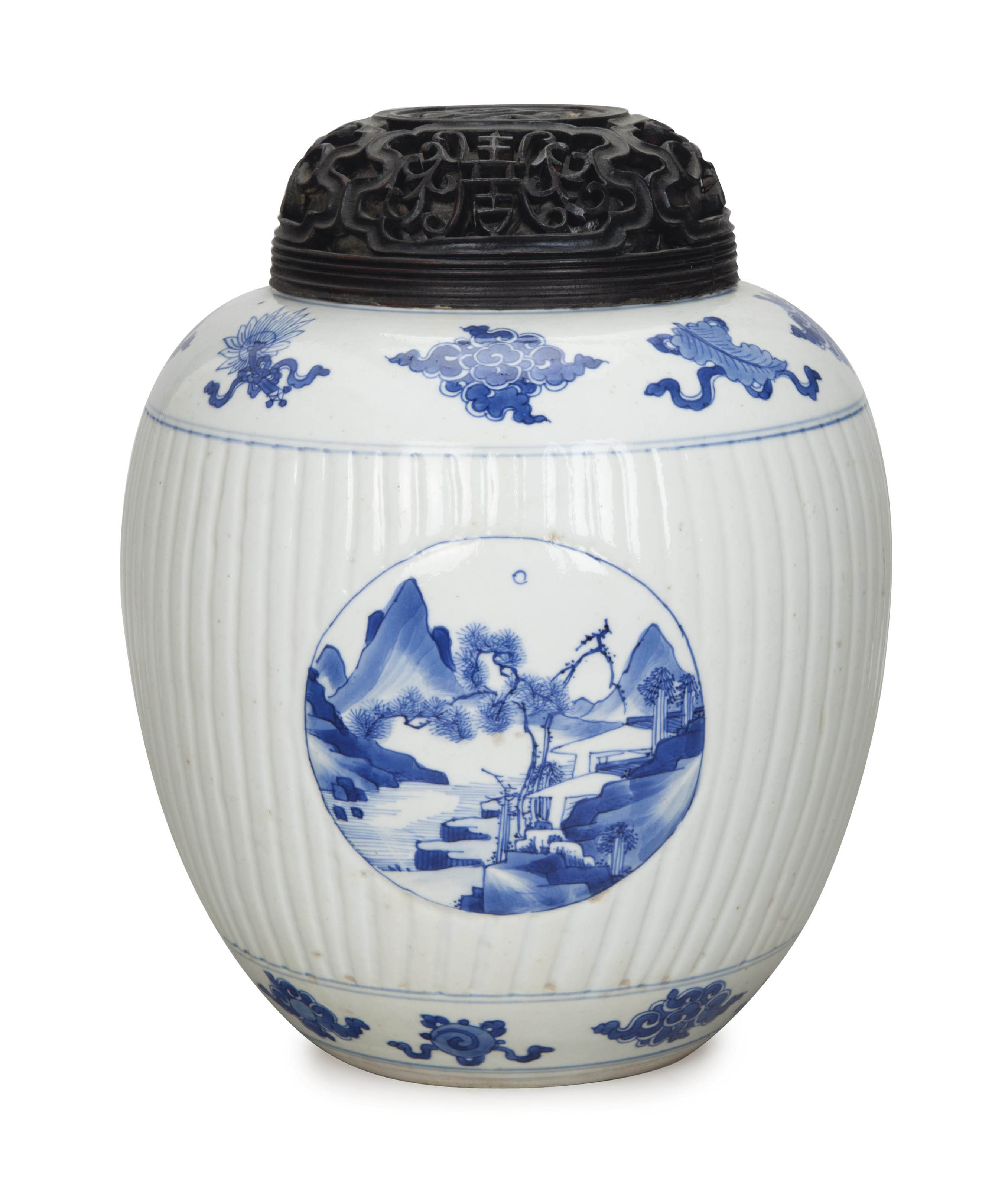 A CHINESE BLUE AND WHITE OVOID JAR WITH A PIERCED WOOD COVER,
