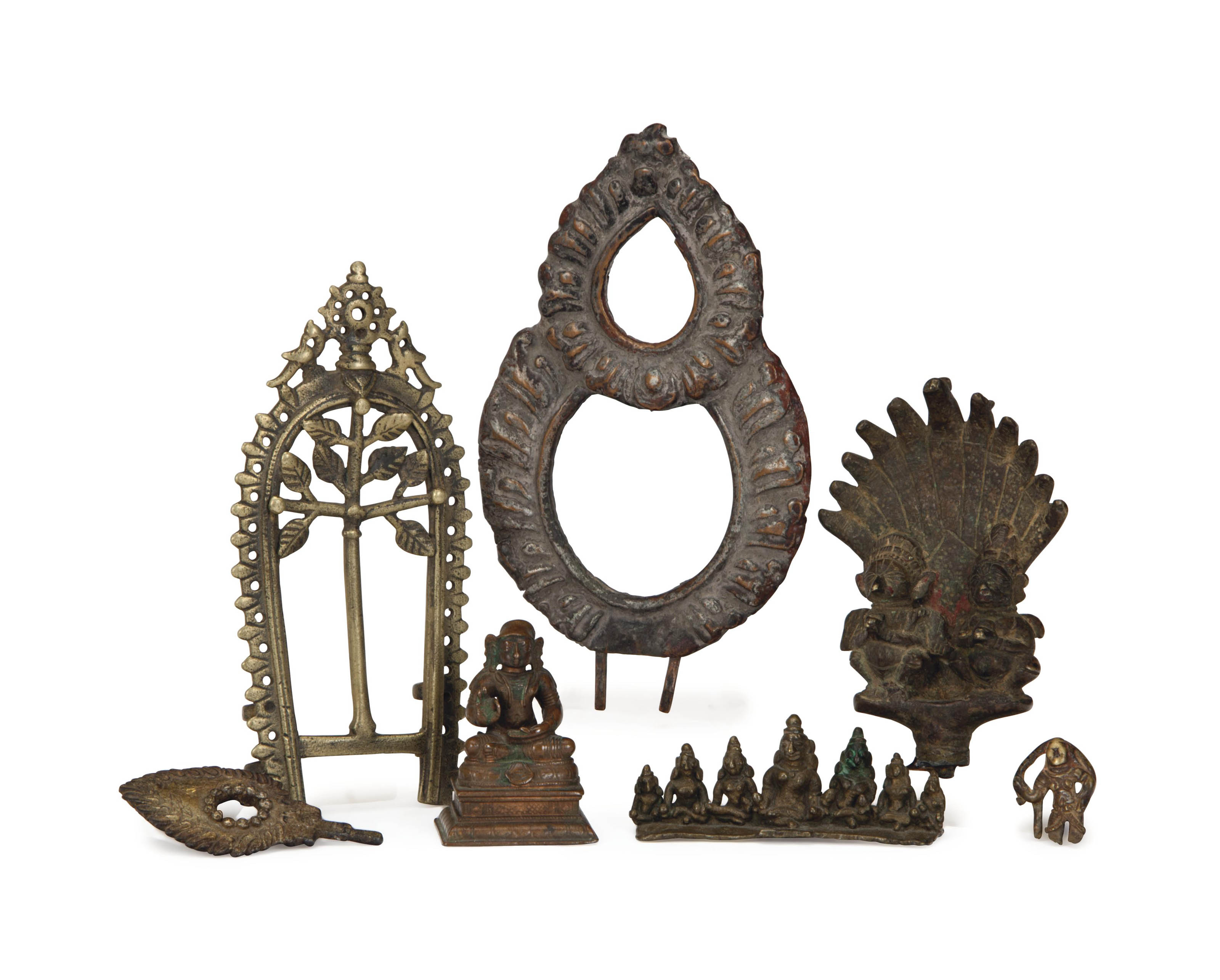 A GROUP OF INDIAN BRONZE FIGURES AND THREE AUREOLES,