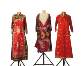 A WAISTED SILK IKAT ROBE AND A CHINESE EMBROIDERED RED SILK