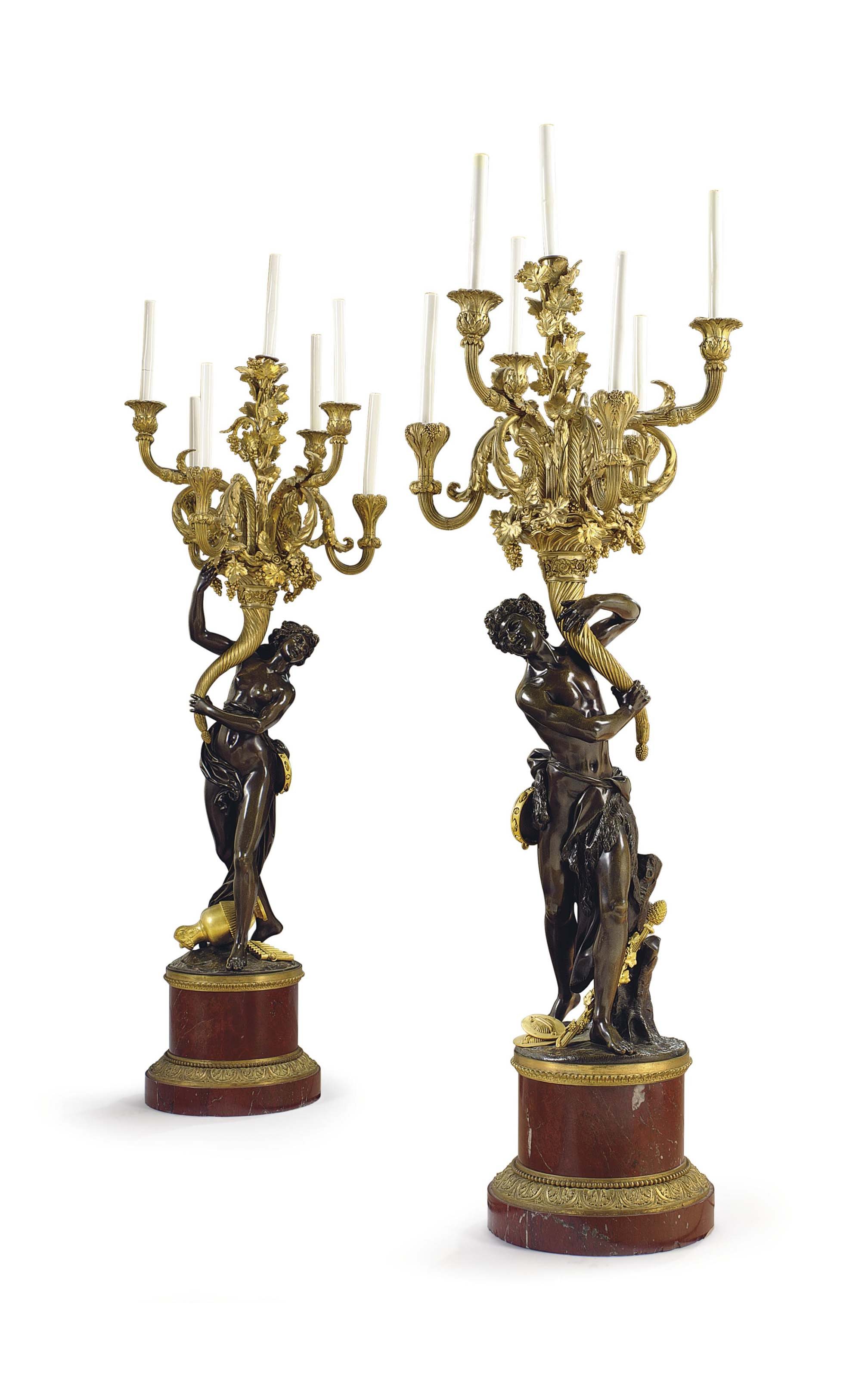 A PAIR OF LARGE FRENCH ORMOLU, PATINATED BRONZE AND ROUGE MARBLE SEVEN-LIGHT CANDELABRA
