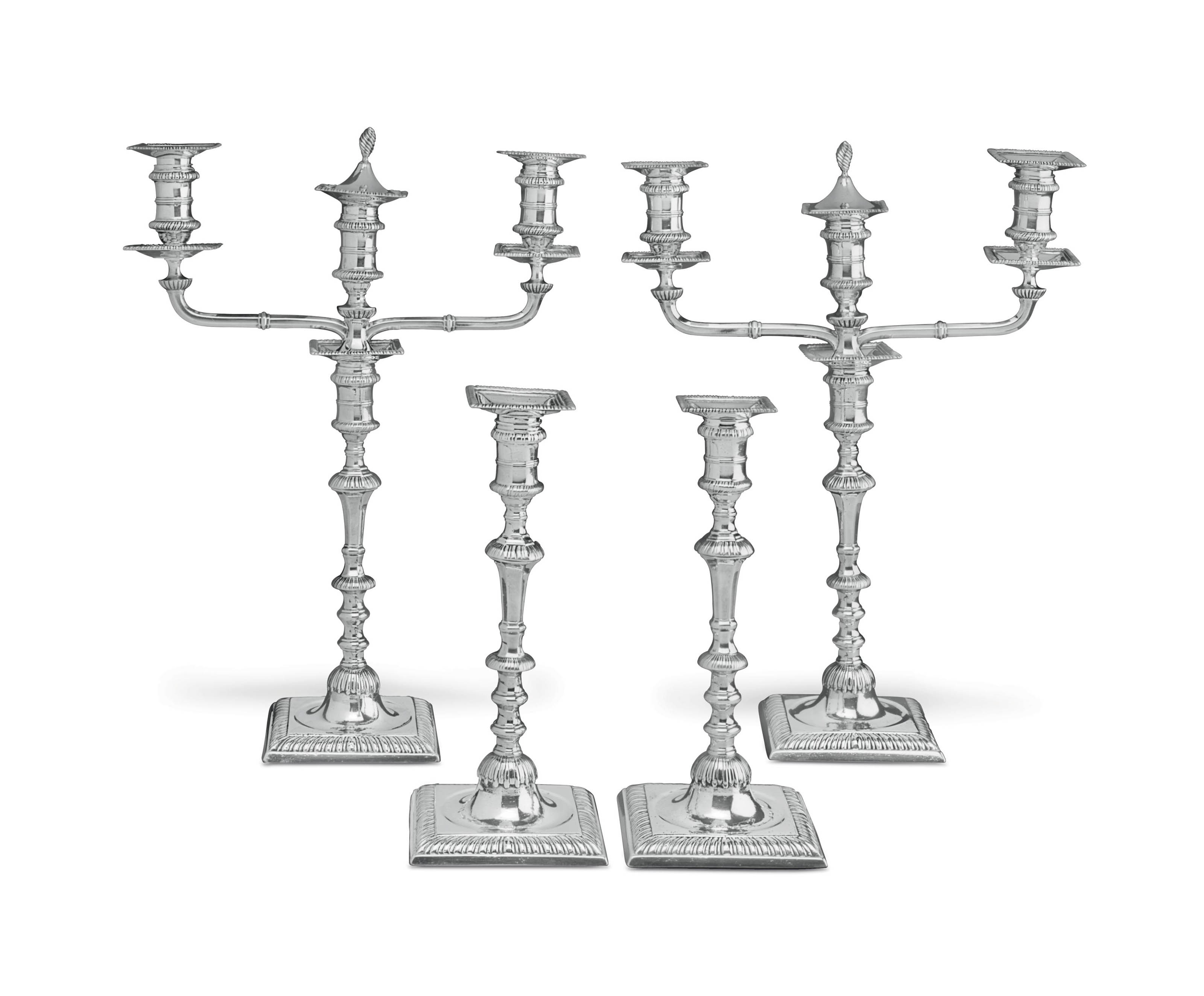 A SET OF FOUR GEORGE III SILVER CANDLESTICKS AND A PAIR OF THREE-LIGHT BRANCHES
