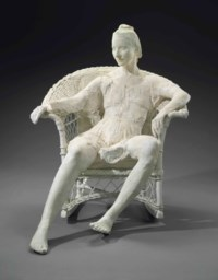 Woman on White Wicker Chair