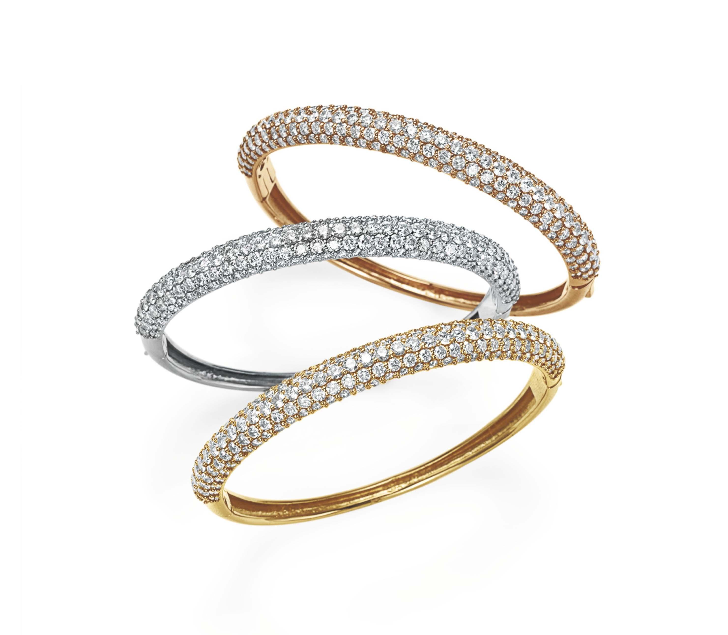 A SET OF THREE GOLD AND DIAMOND BANGLE BRACELETS