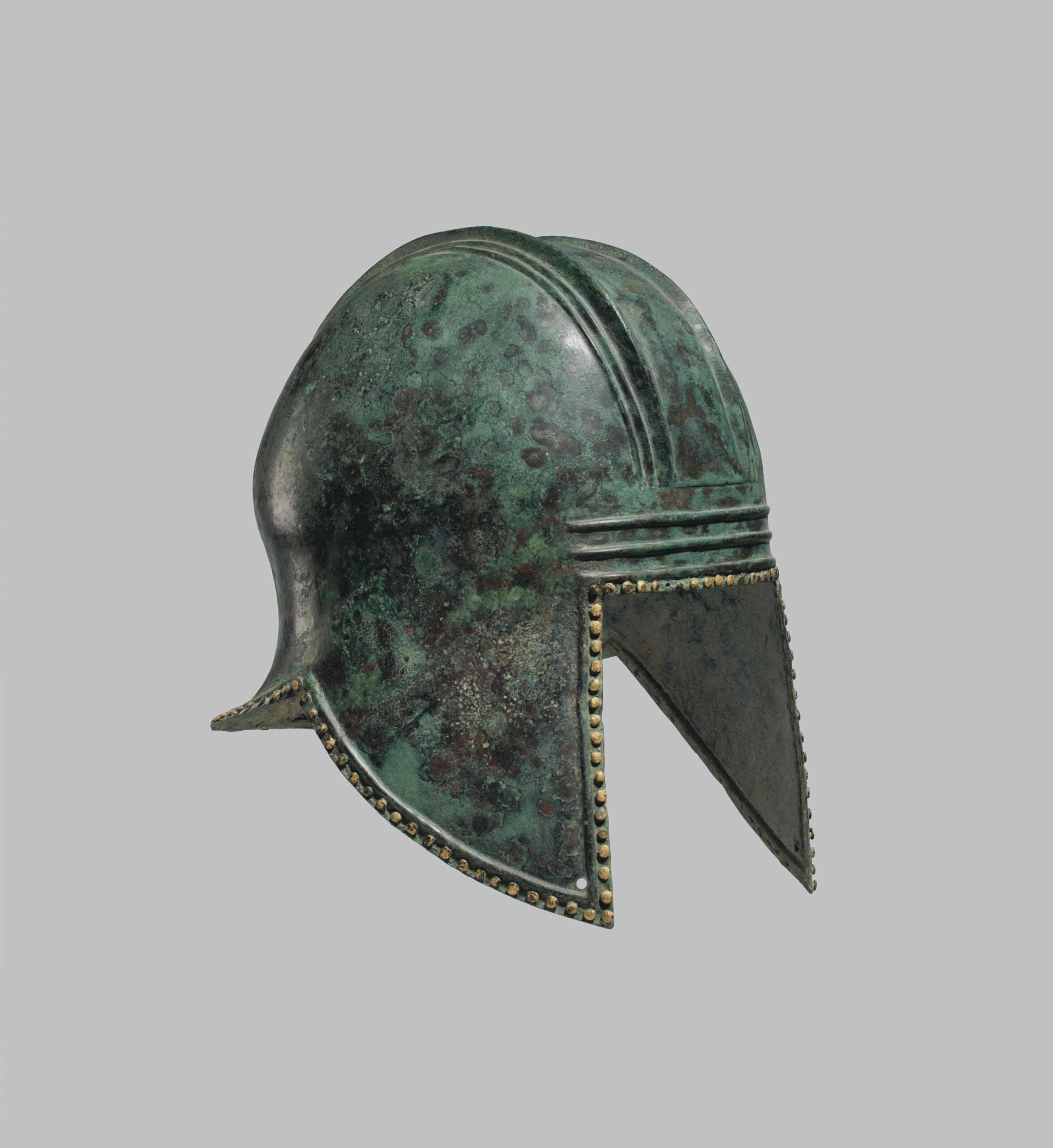 A GREEK BRONZE ILLYRIAN HELMET