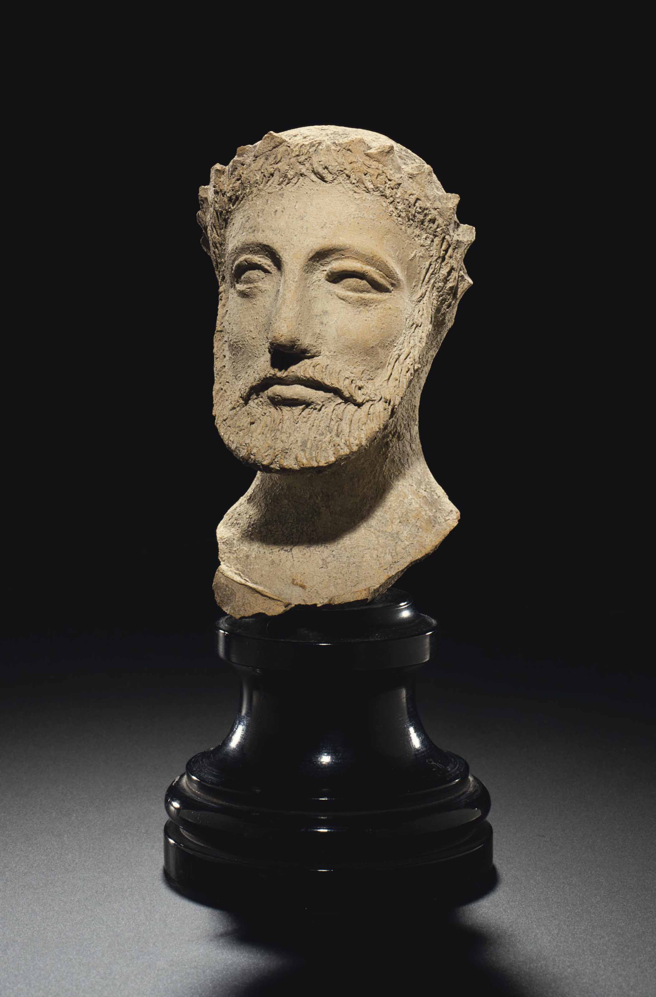 A CYPRIOT TERRACOTTA MALE HEAD