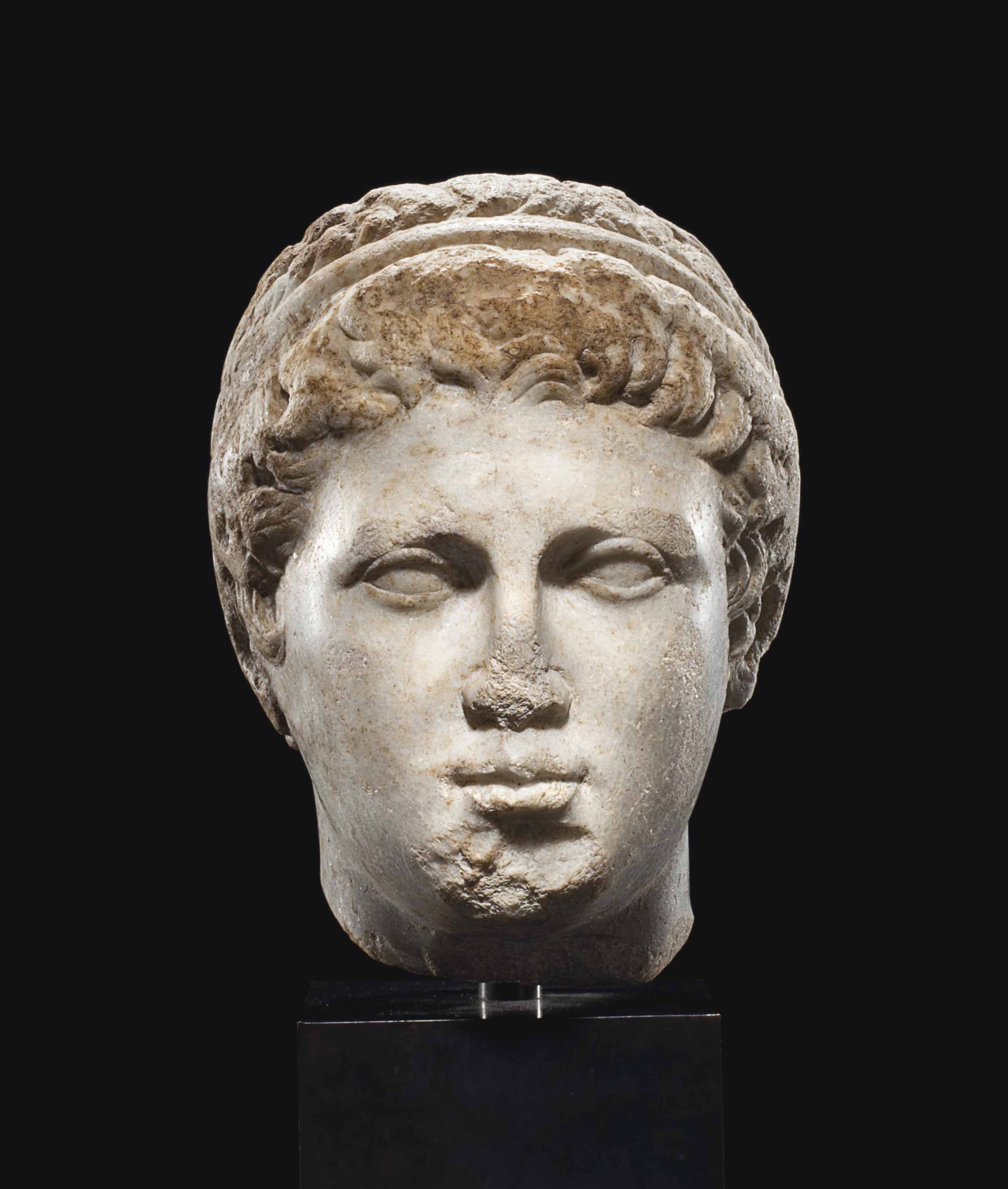 A GREEK MARBLE HEAD OF A YOUTH