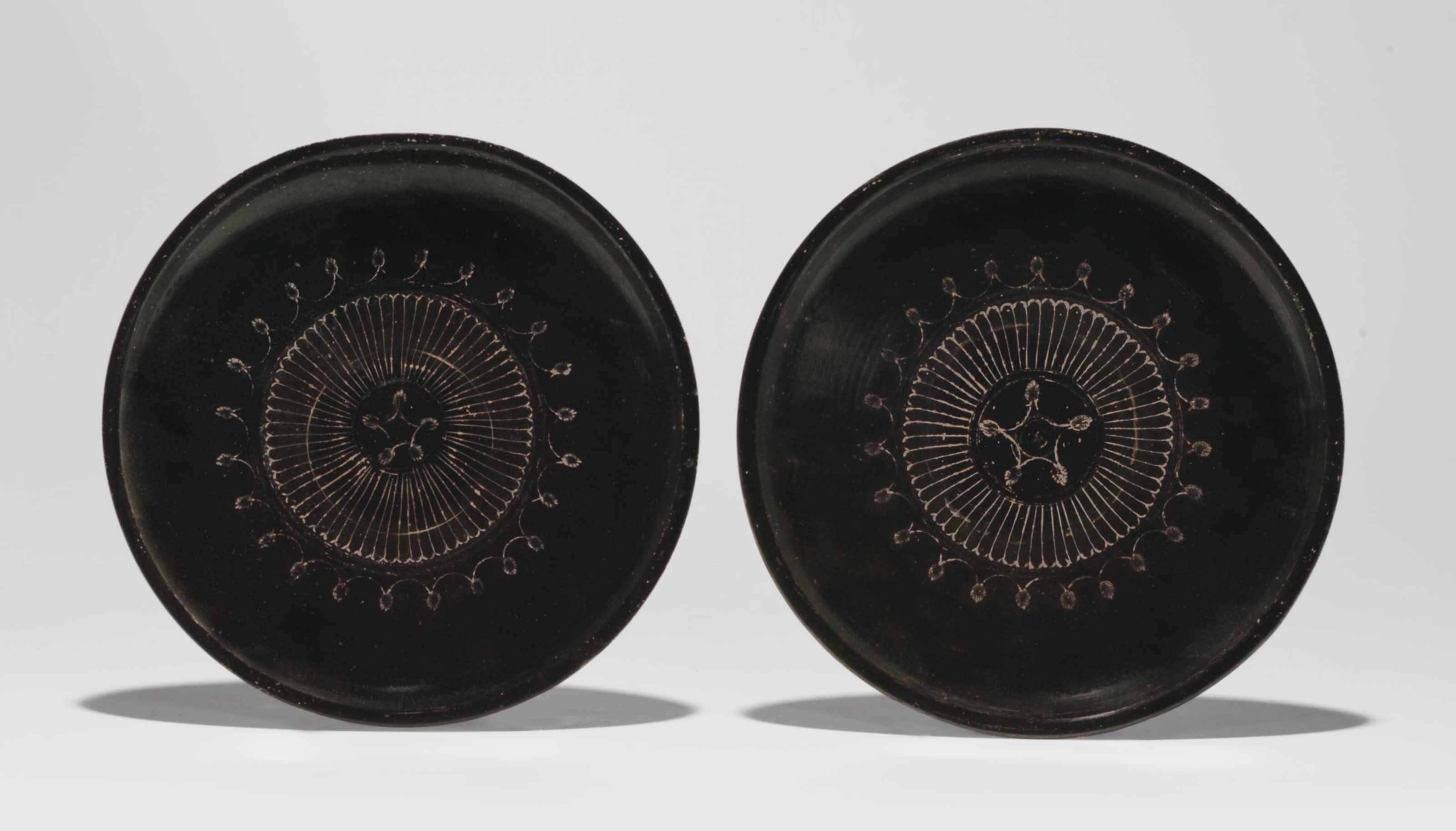 TWO ATTIC BLACK-GLAZED PLATES