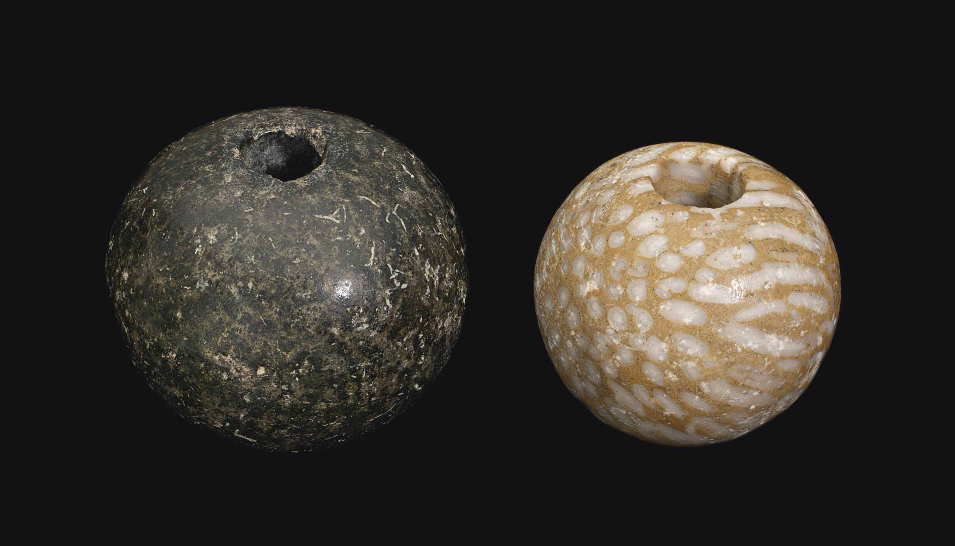 TWO EGYPTIAN STONE MACE HEADS