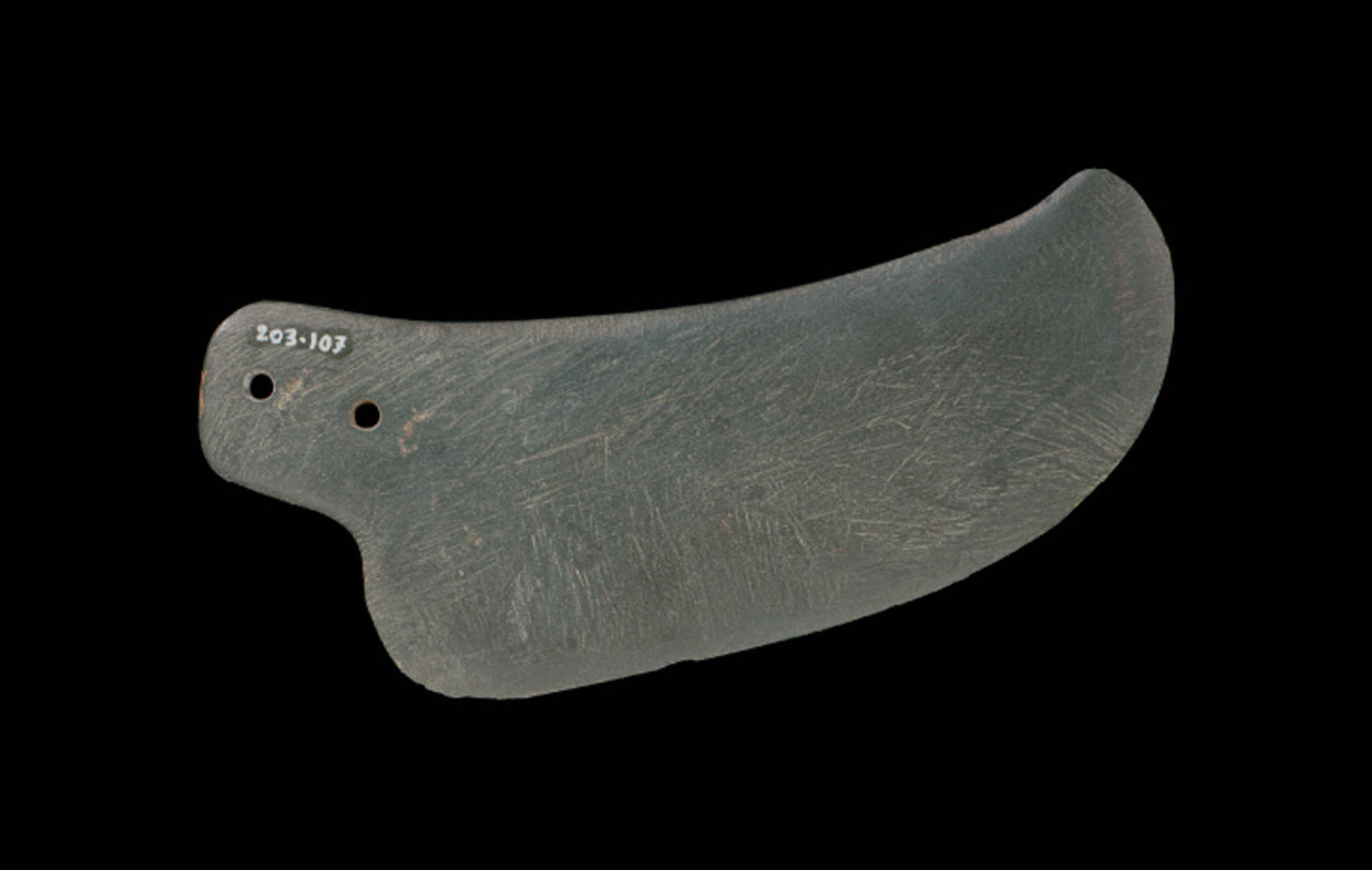 AN EGYPTIAN GRAYWACKE BLADE