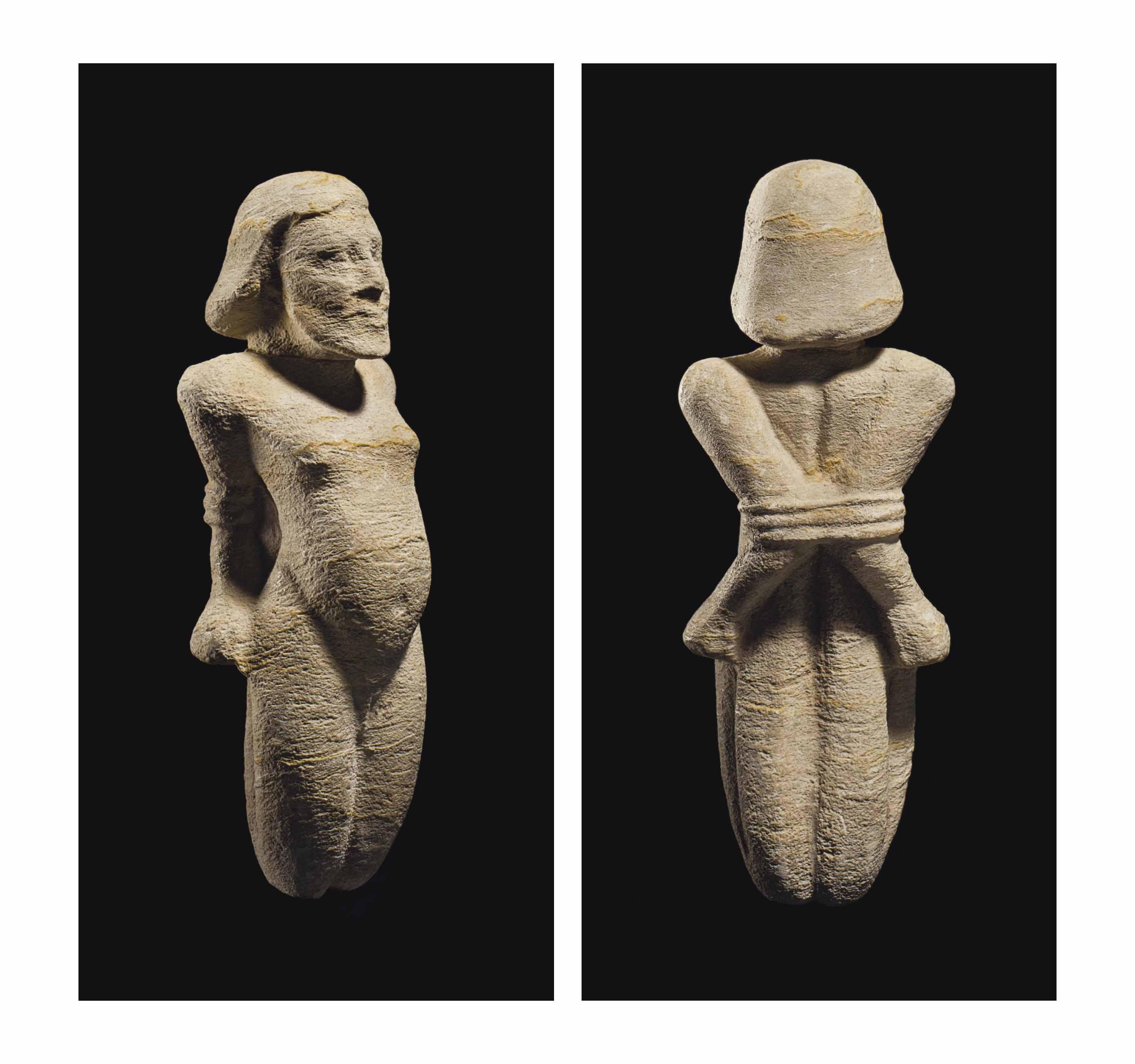 AN EGYPTIAN LIMESTONE BOUND PR