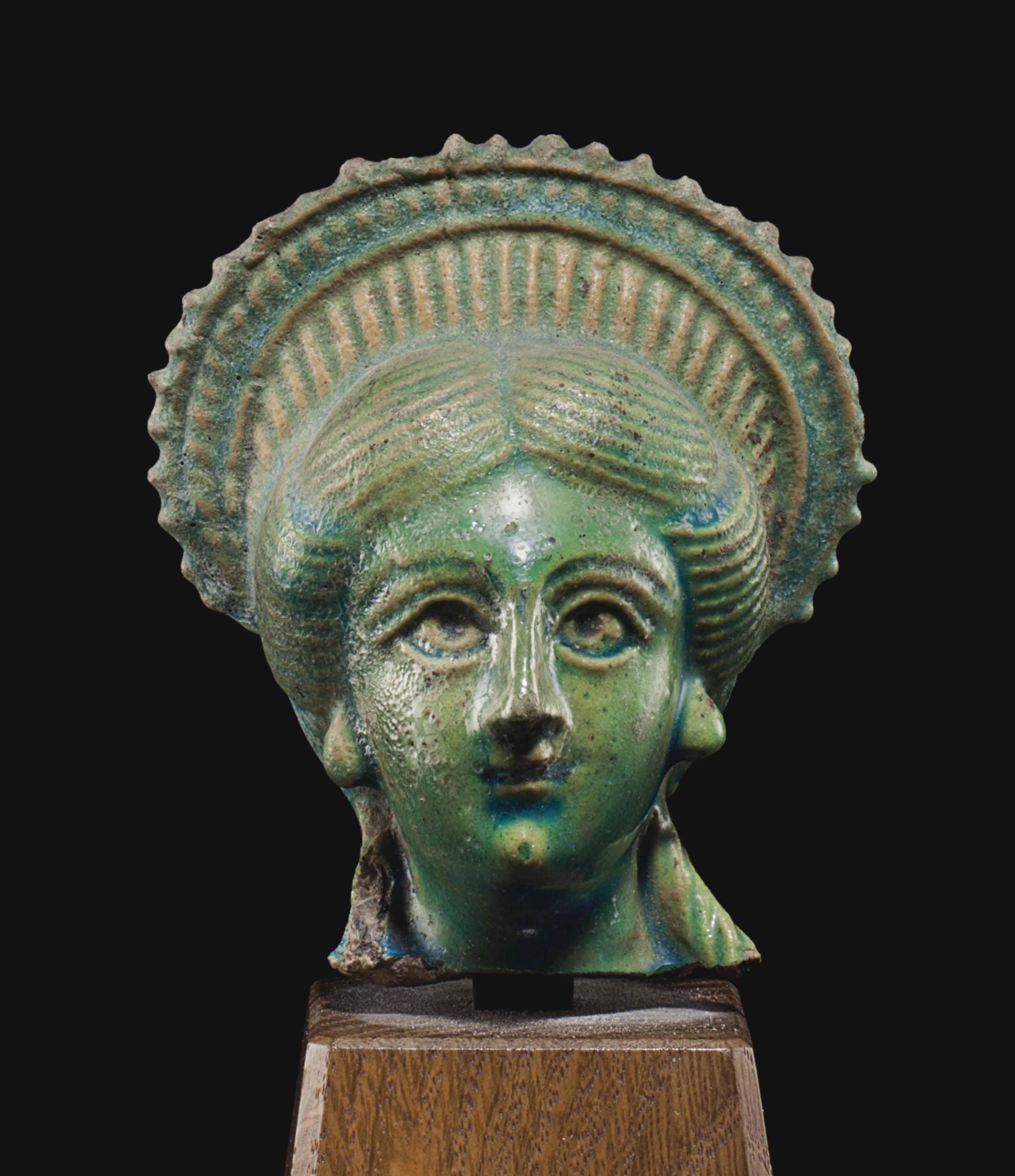 AN EGYPTIAN FAIENCE HEAD OF IS