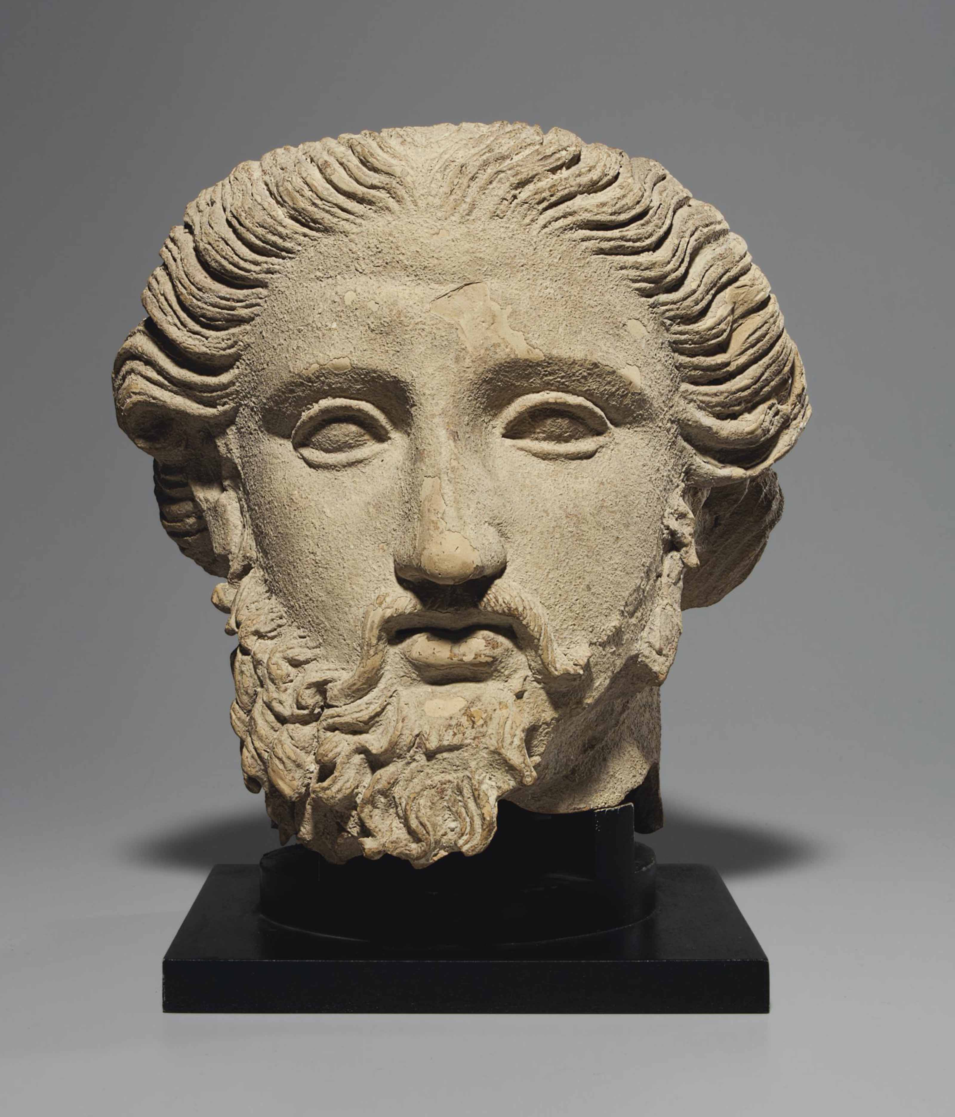 A GREEK TERRACOTTA HEAD OF A B