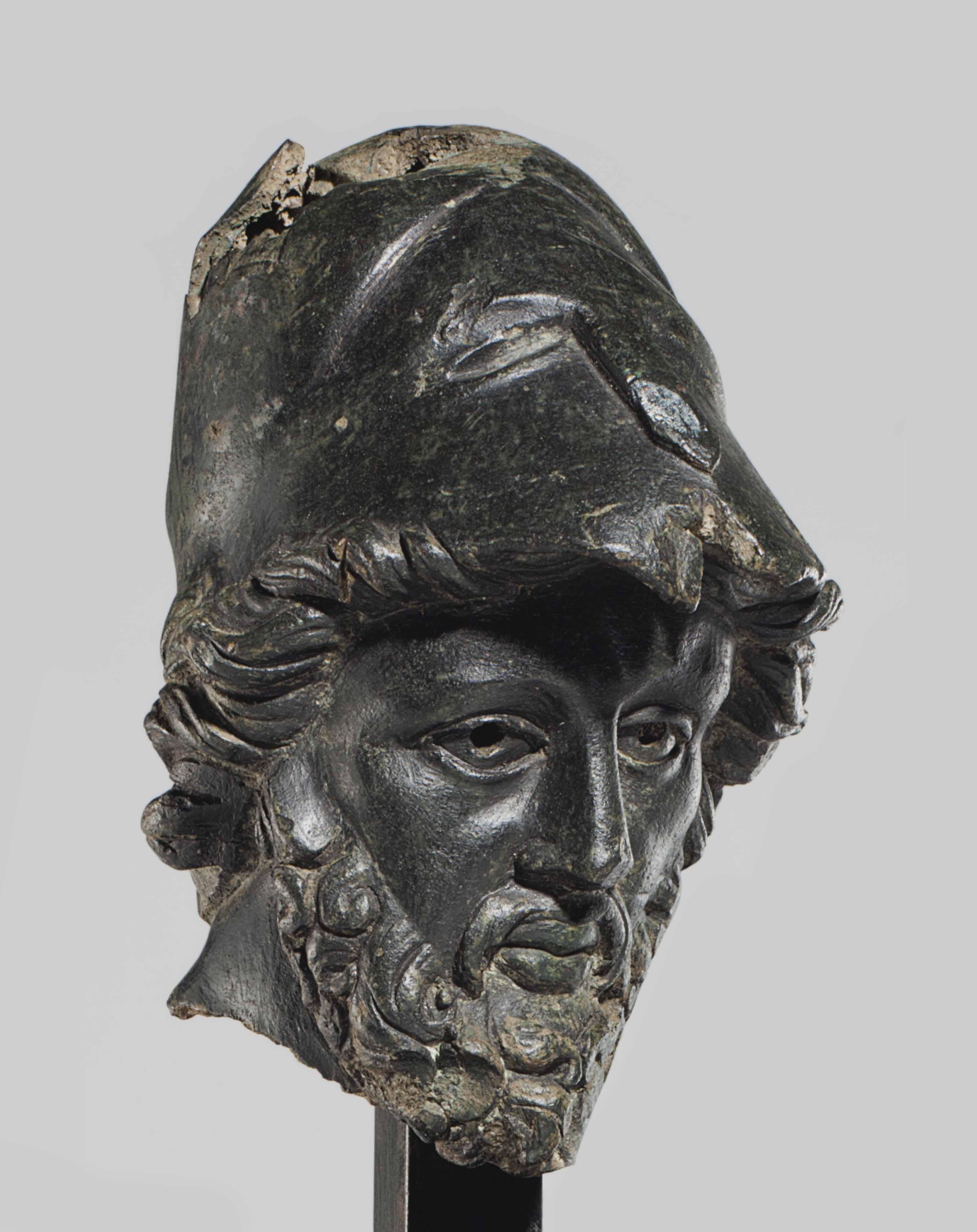 A ROMAN BRONZE HELMETED HEAD