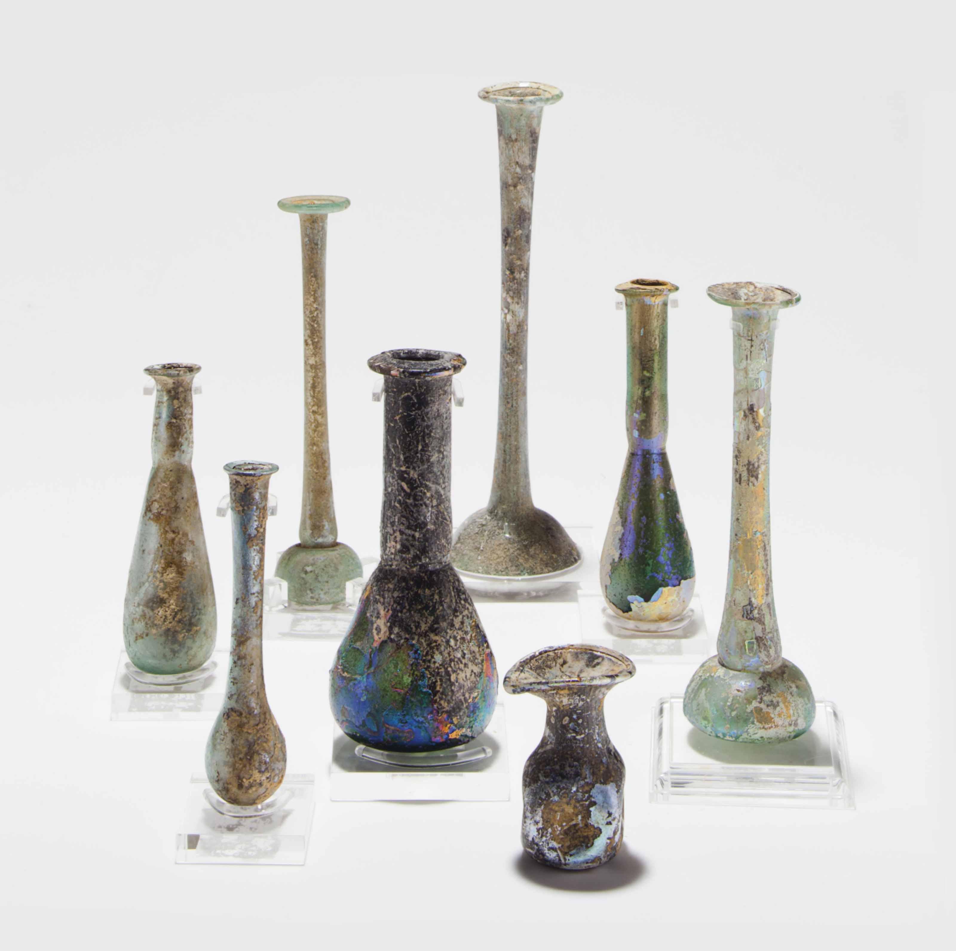 EIGHT ROMAN GLASS VESSELS