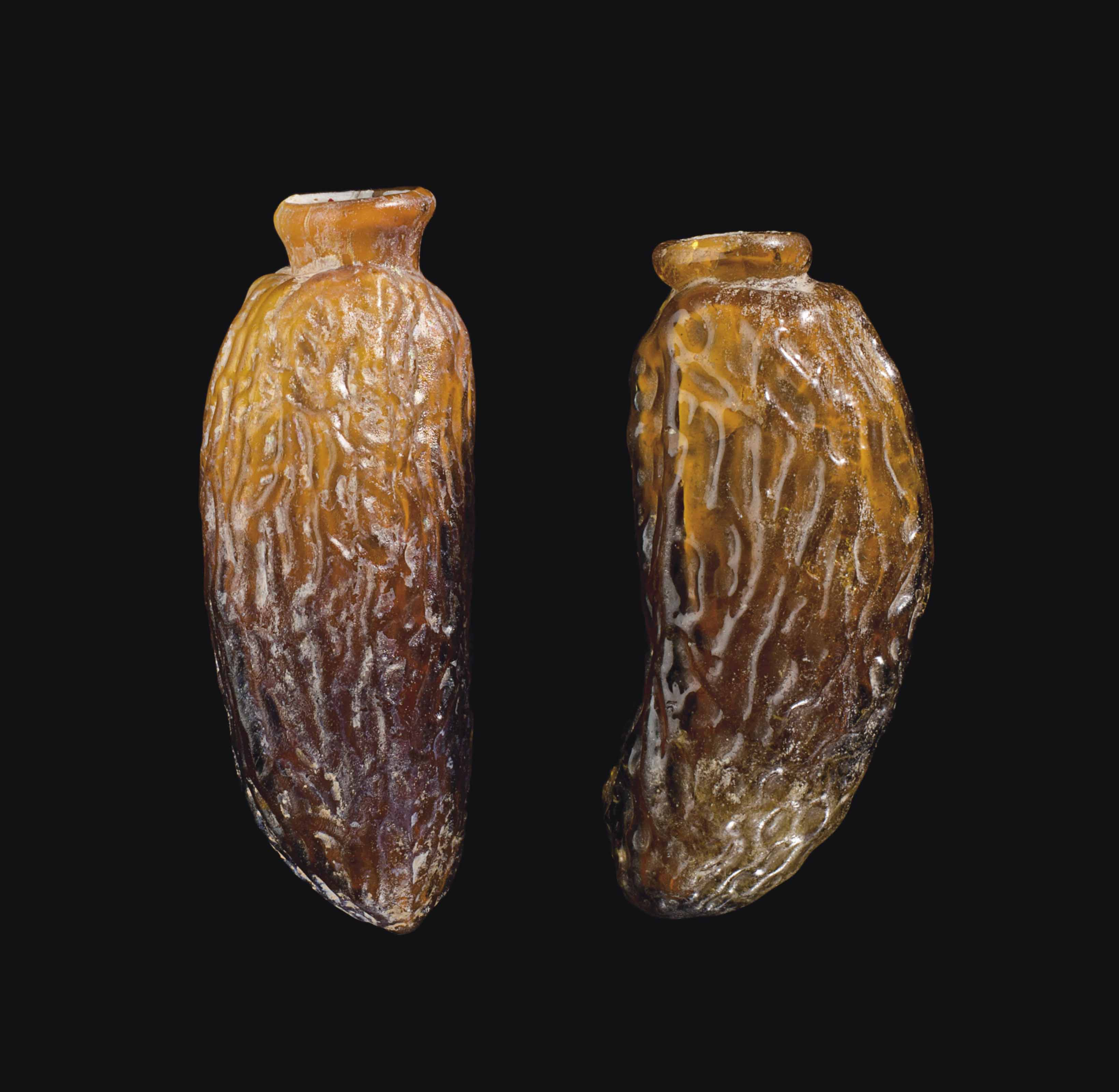 TWO ROMAN GLASS DATE FLASKS