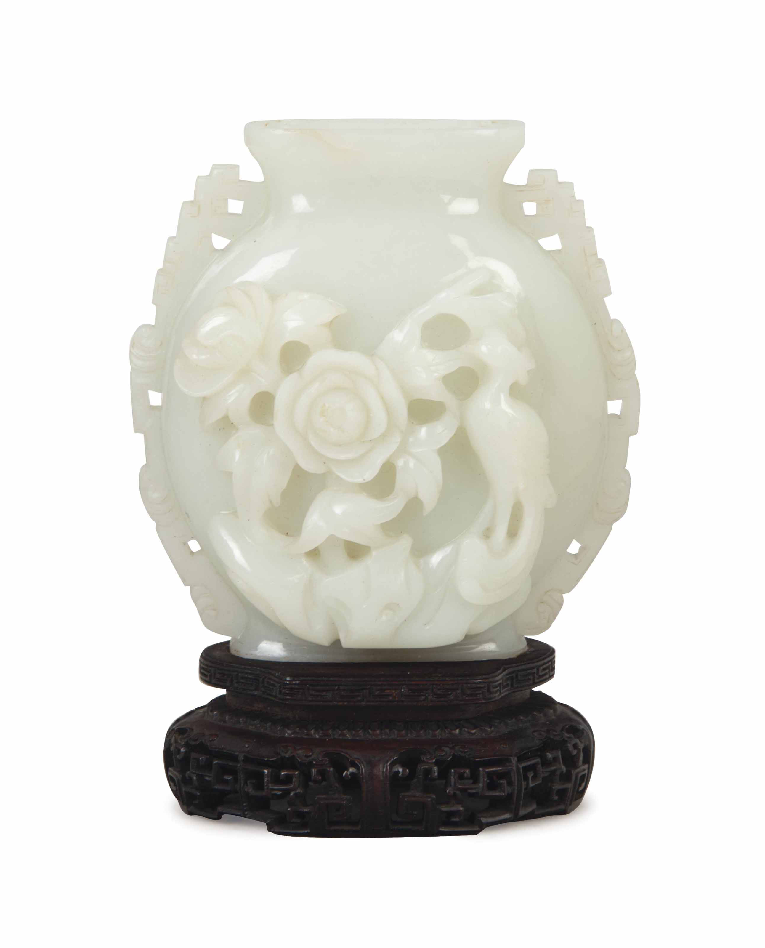 A CHINESE WHITE JADE VASE,