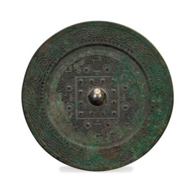A CHINESE BRONZE MIRROR,