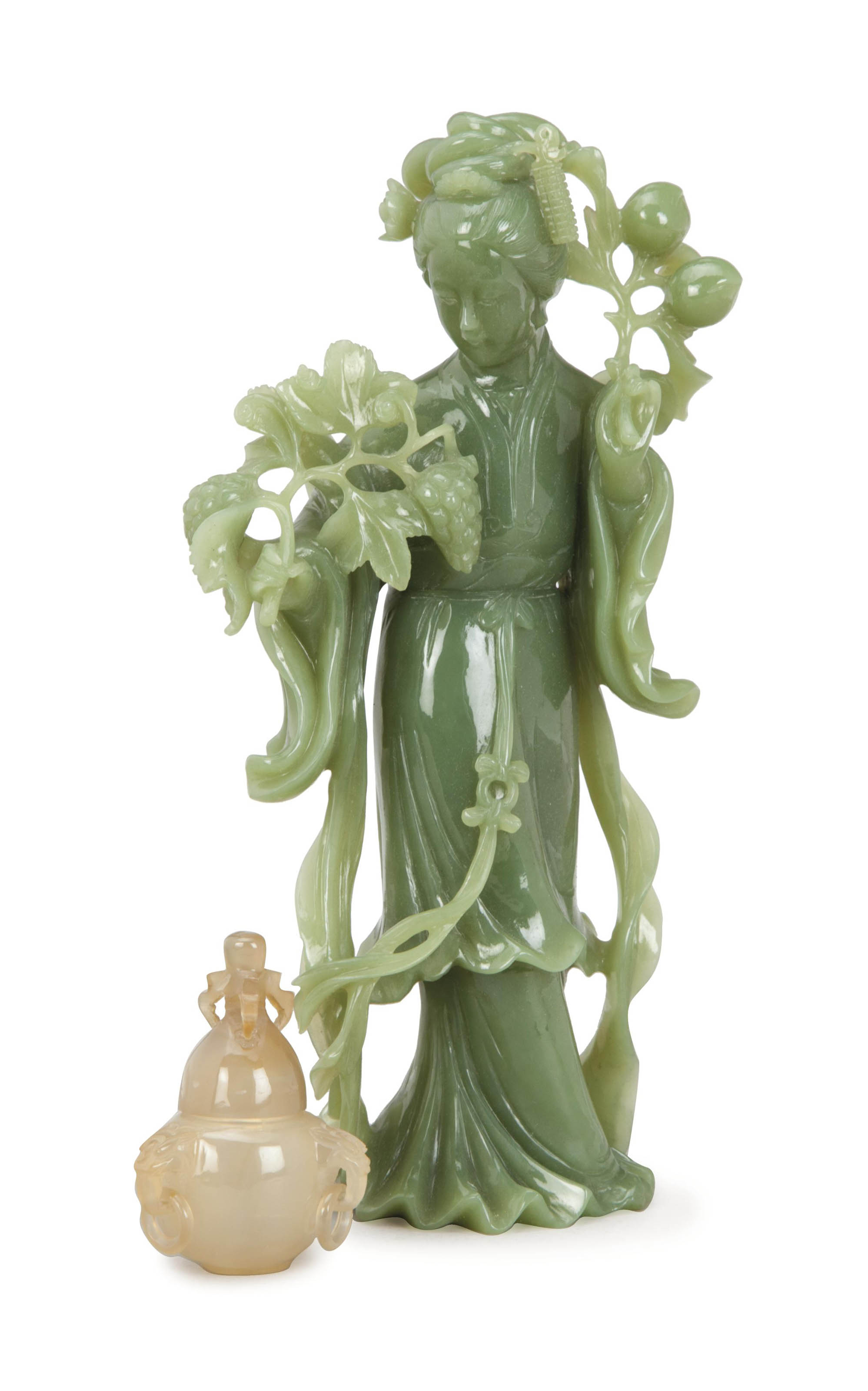 A CHINESE SERPENTINE FIGURE OF
