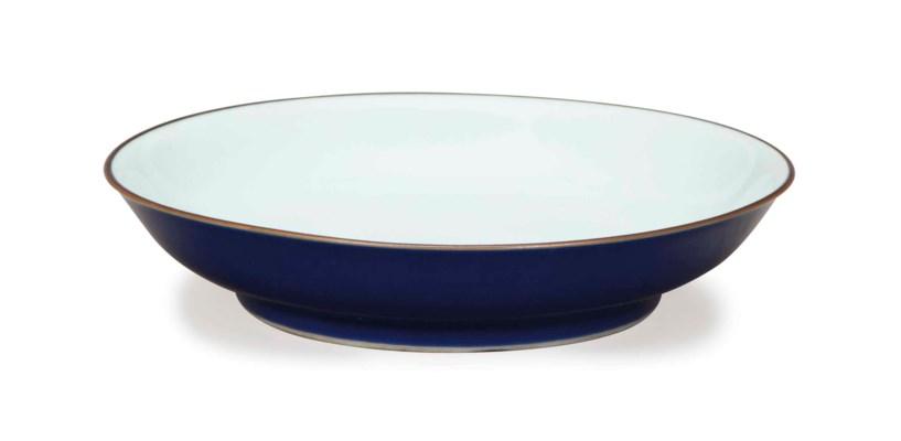 A CHINESE BLUE-GLAZED DISH,