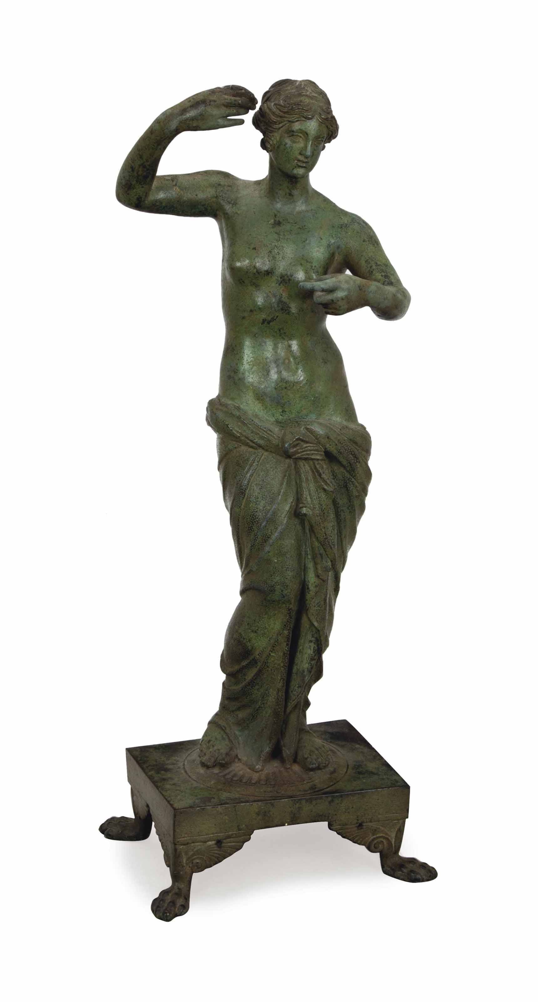 A PATINATED-METAL FIGURE OF A